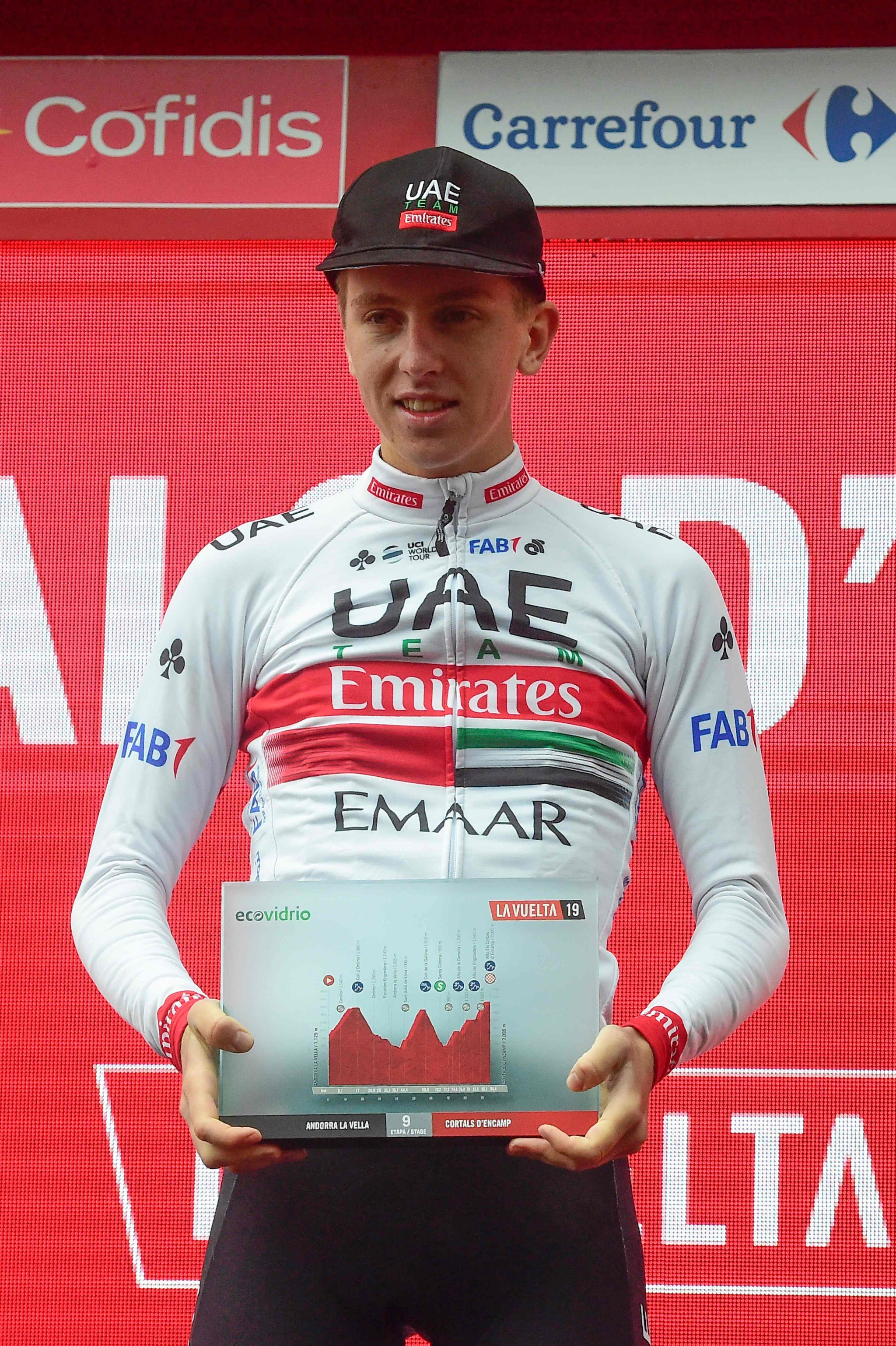 Team UAE Emirates rider Slovenias Tadej <HIT>Pogacar</HIT> celebrates on the podium after winning the ninth stage of the 2019 La Vuelta cycling tour of Spain, a 94,4 km race from Andorra la Vella to Cortals dEncamp on September 1, 2019 in Els Cortals. (Photo by JOSE JORDAN / AFP)