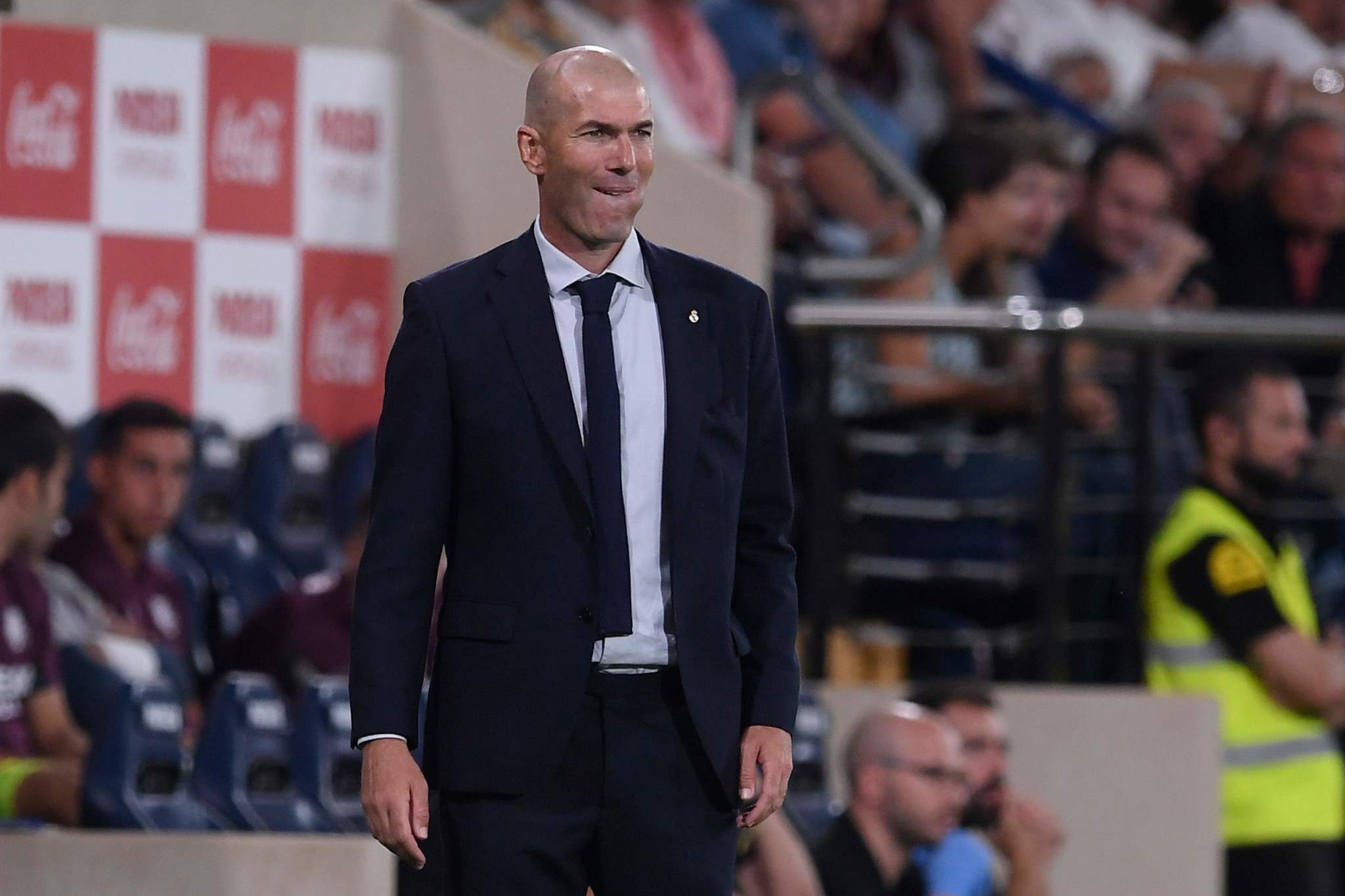 Real Madrids French coach Zinedine <HIT>Zidane</HIT> reacts during the Spanish league football match Villarreal CF against Real Madrid CF at La Ceramica stadium in Vila-real on September 1, 2019. (Photo by Josep LAGO / AFP)