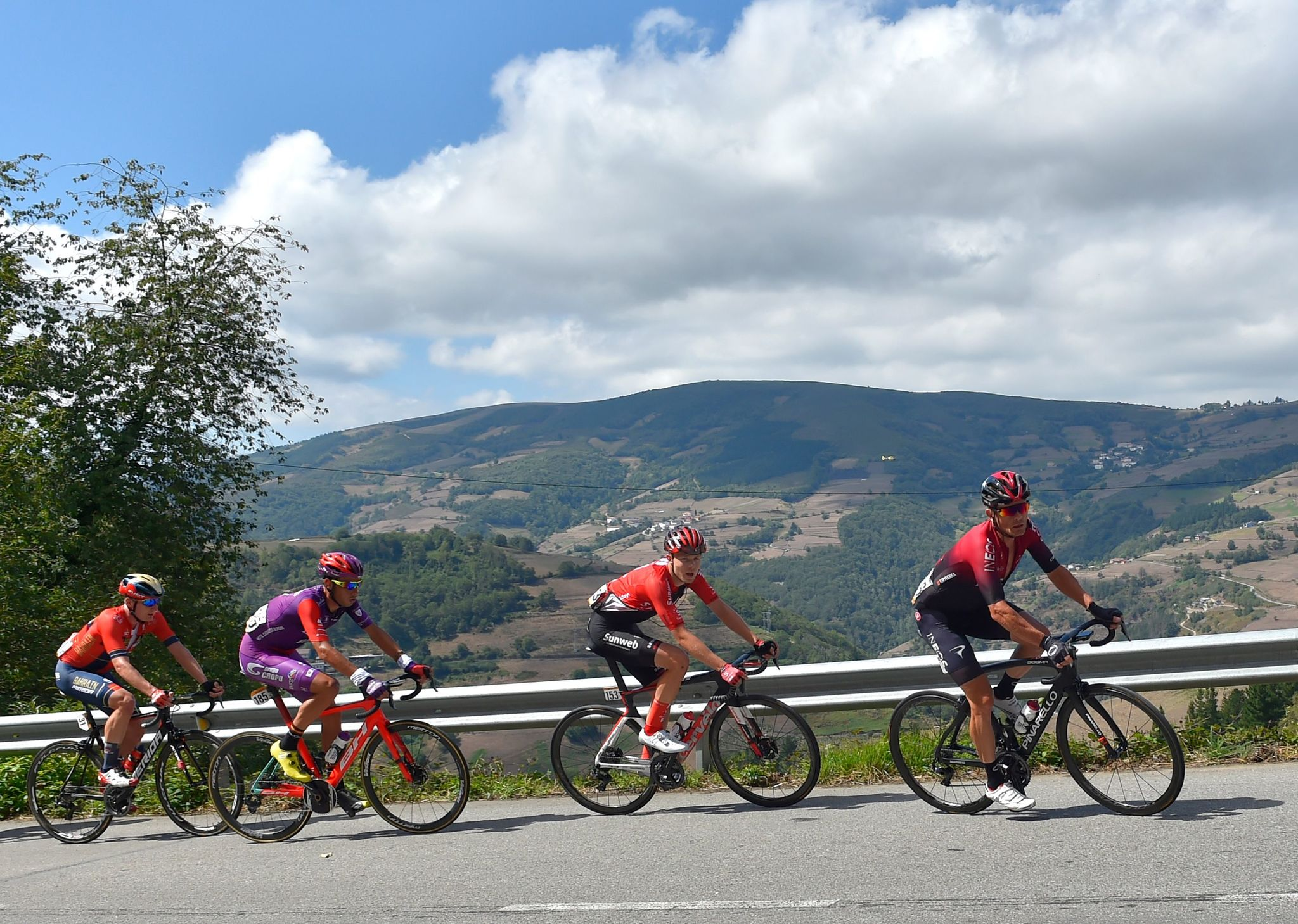 (L to R) Team Bahrain rider Ukraines Mark Padun, Team Burgos - BH rider Spains Jesus Ezquerra, Team Sunweb rider Denmarks Casper Pedersen and Team Ineos rider Belarus Vasil Kiryienka ride ahead of the pack during the 15th stage of the 2019 La <HIT>Vuelta</HIT> cycling Tour of Spain, a 154,4 km race from Tineo to Santuario del Acebo in Cangas del Narcea on September 8, 2019. (Photo by ANDER GILLENEA / AFP)