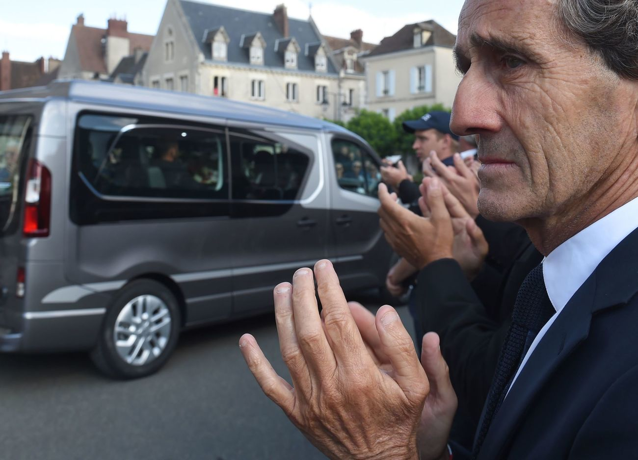 Retired French F1 racing driver and Renault special advisor Alain Prost applause at the funeral procession of the late BWT Arden's French driver Anthoine Hubert outside the Cathedral of Notre Dame, in Chartres, on September 10, 2019, in Chartres, center France. - The 22-year-old F2 driver was killed on August 31, 2019 in a crash on the Spa-Francorchamps circuit. (Photo by JEAN-FRANCOIS MONIER / AFP)