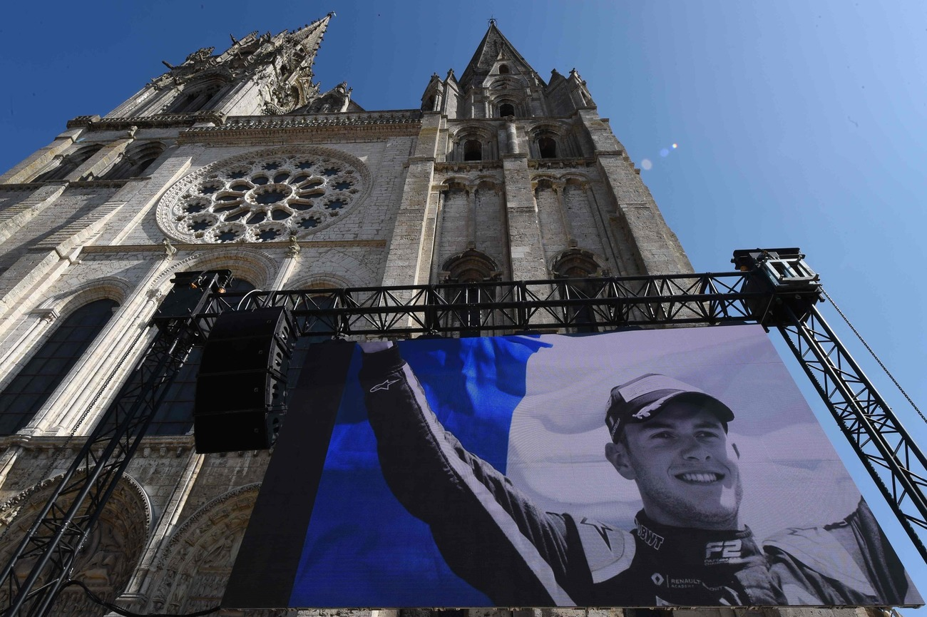 TOPSHOT - A portrait of late French racing driver Anthoine Hubert is displayed on a giant screen outside Chartres' cathedral ahead of his funeral ceremony, on September 10, 2019. - The 22-year-old F2 driver was killed on August 31, 2019 in a crash on the Spa-Francorchamps circuit. (Photo by JEAN-FRANCOIS MONIER / AFP)