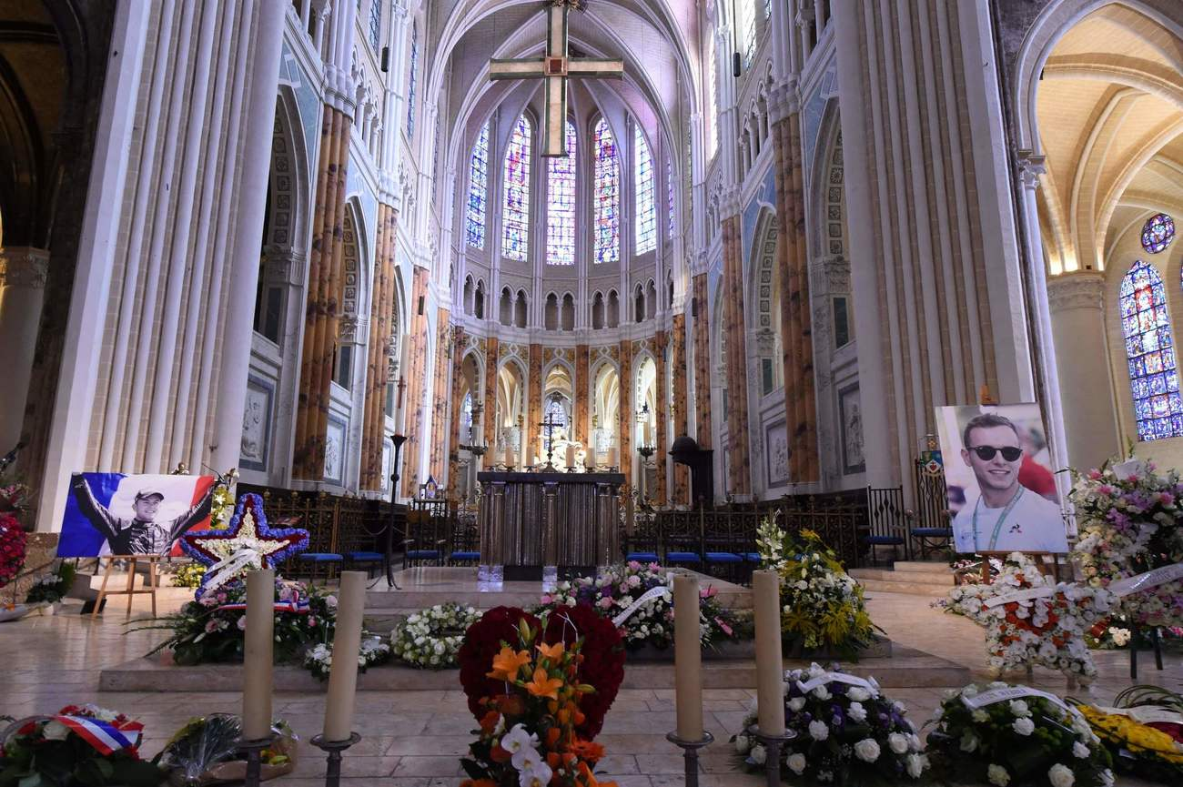 Portraits of late French racing driver Anthoine Hubert are displayed in Chartres' cathedral ahead of his funeral ceremony, on September 10, 2019. - The 22-year-old F2 driver was killed on August 31, 2019 in a crash on the Spa-Francorchamps circuit. (Photo by JEAN-FRANCOIS MONIER / AFP)