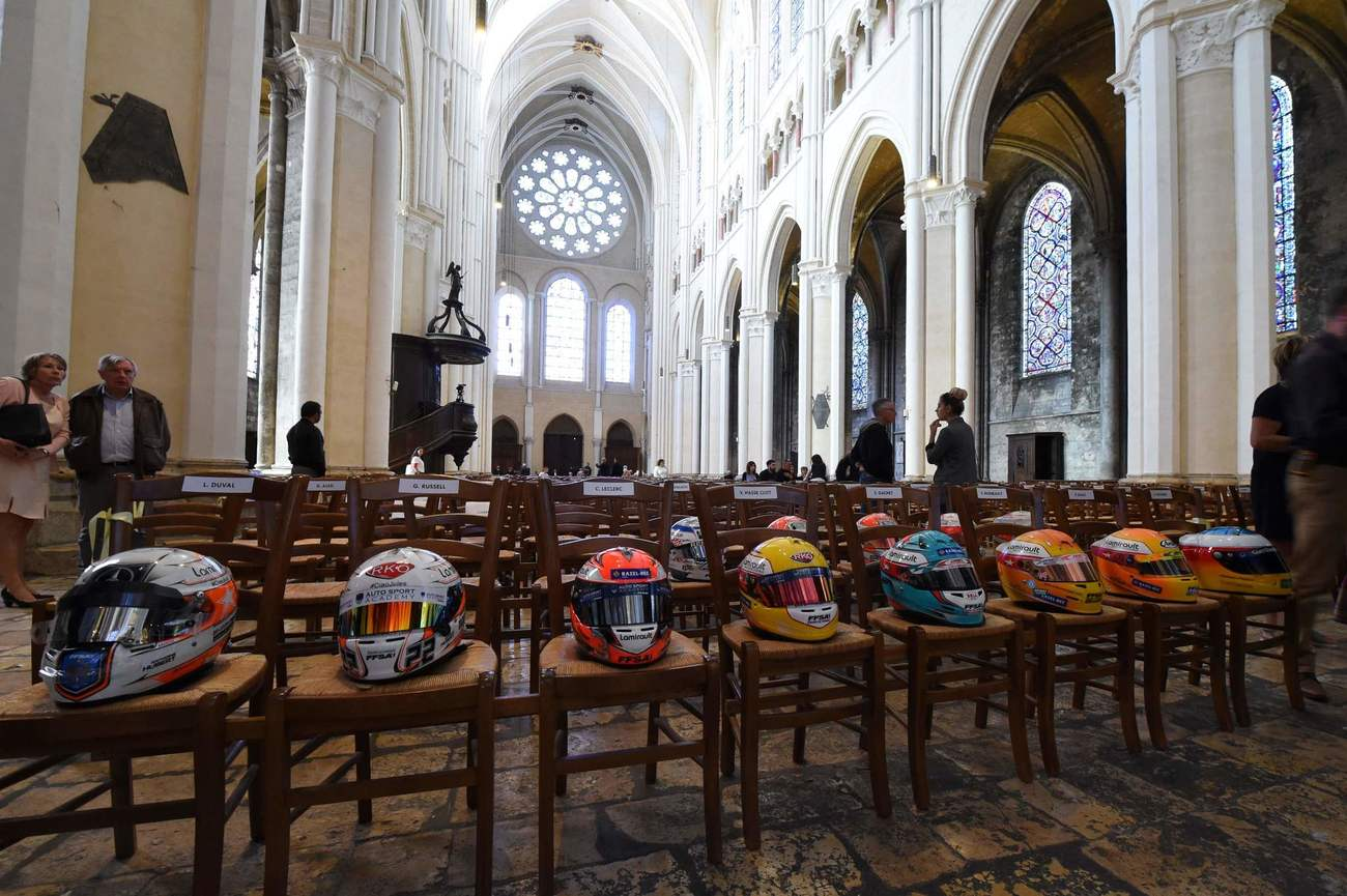 Drivers' helmets are laid on chairs ahead of the funeral ceremony of late French racing driver Anthoine Hubert at Chartres' cathedral, on September 10, 2019. - The 22-year-old F2 driver was killed on August 31, 2019 in a crash on the Spa-Francorchamps circuit. (Photo by JEAN-FRANCOIS MONIER / AFP)