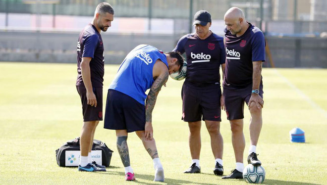 Lionel Messi tells the club's medical team where he feels the...