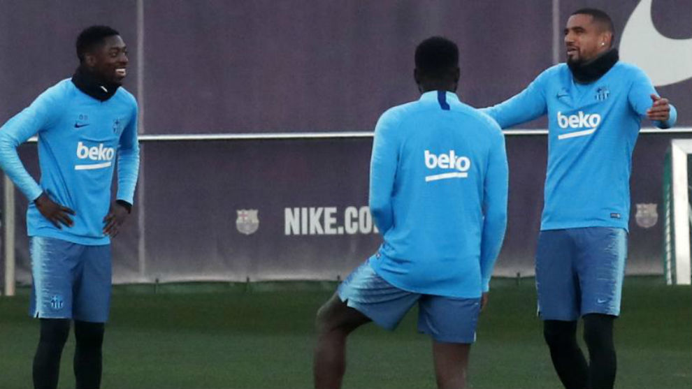 Ousmane Dembele, Samuel Umtiti and Kevin-Prince Boateng in a training...