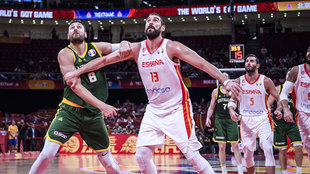 Andrew Bogut (Australia) and Marc Gasol (Spain) wait for the ball to...