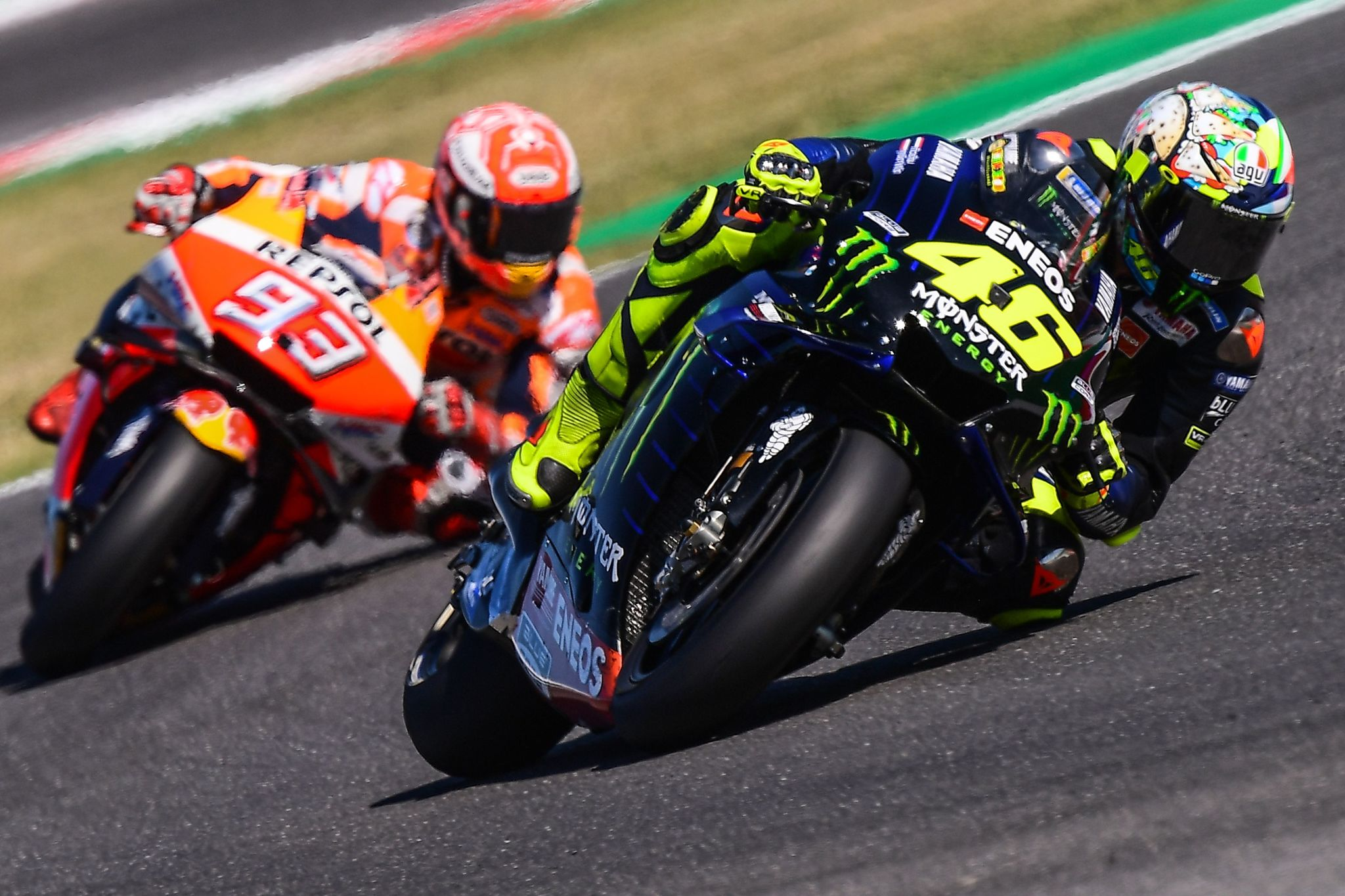 TOPSHOT - Monster Energy Yamaha Italian rider, Valentino <HIT>Rossi</HIT> (R) and Repsol Honda Team Spanish rider, Marc <HIT>Marquez</HIT> steer their motorbikes during the Q2 qualifying session ahead of the San Marino MotoGP Grand Prix race at the Misano World Circuit Marco Simoncelli on September 14, 2019. (Photo by Marco Bertorello / AFP)