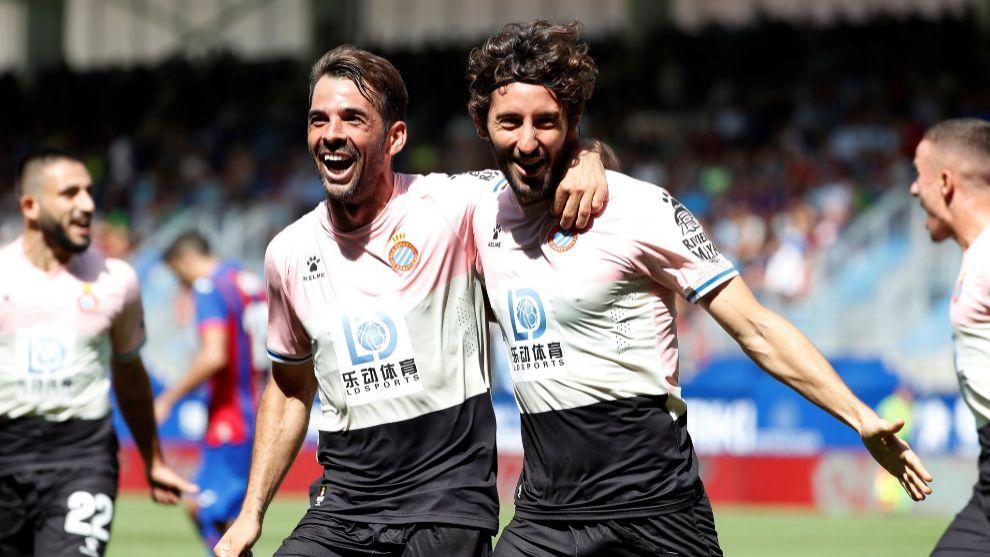 Victor Sanchez and Esteban Granero celebrate Espanyol's second goal.