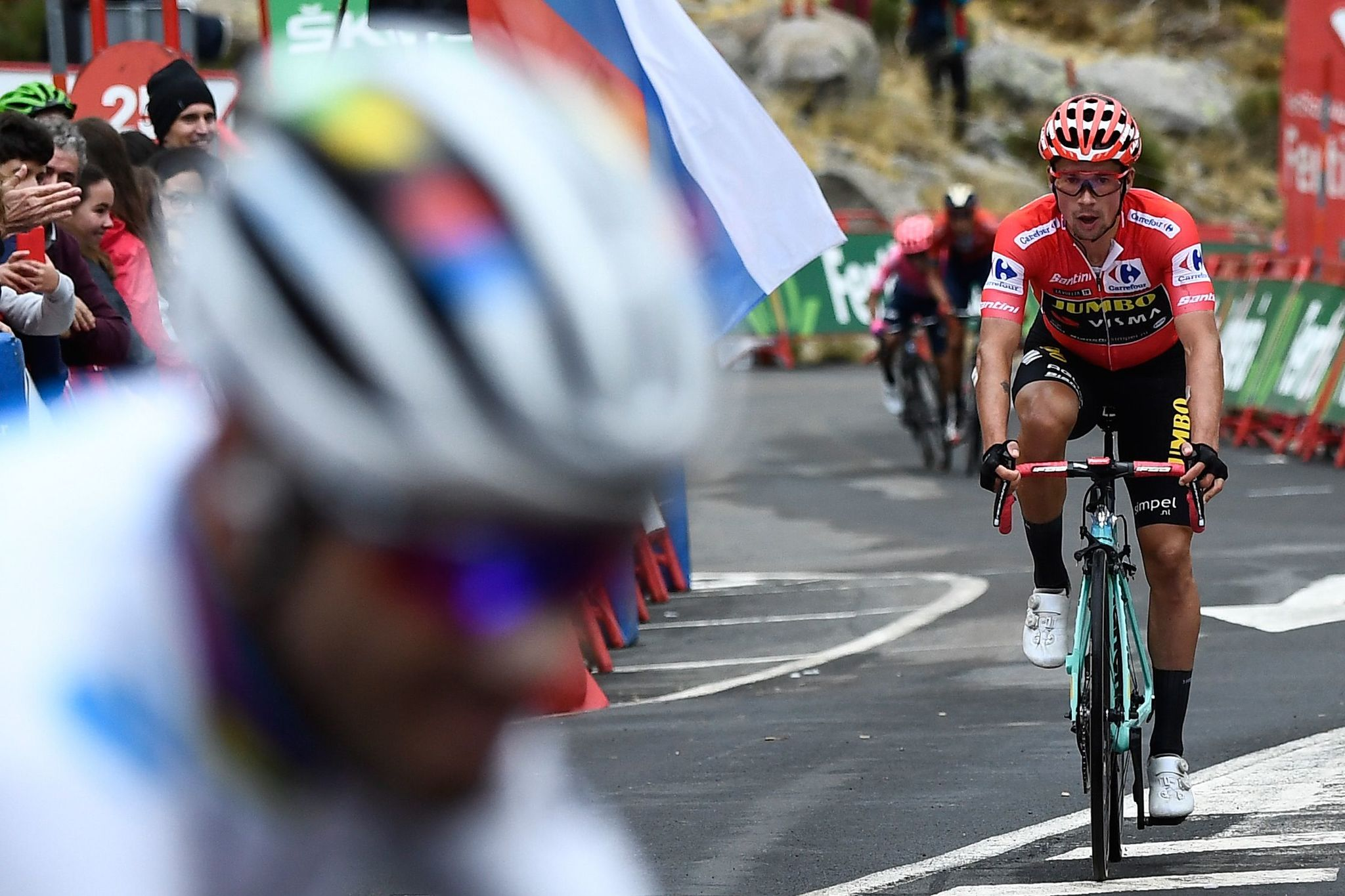 Team Jumbo rider Slovenias Primoz <HIT>Roglic</HIT> (R) crosses the finish line next to Team Movistar rider Spains Alejandro Valverde (L) at the end of the 20th stage of the 2019 La Vuelta cycling Tour of Spain, a 190,4 km race from Arenas de San Pedro to Plataforma de Gredos on September 14, 2019. (Photo by OSCAR DEL POZO / AFP)