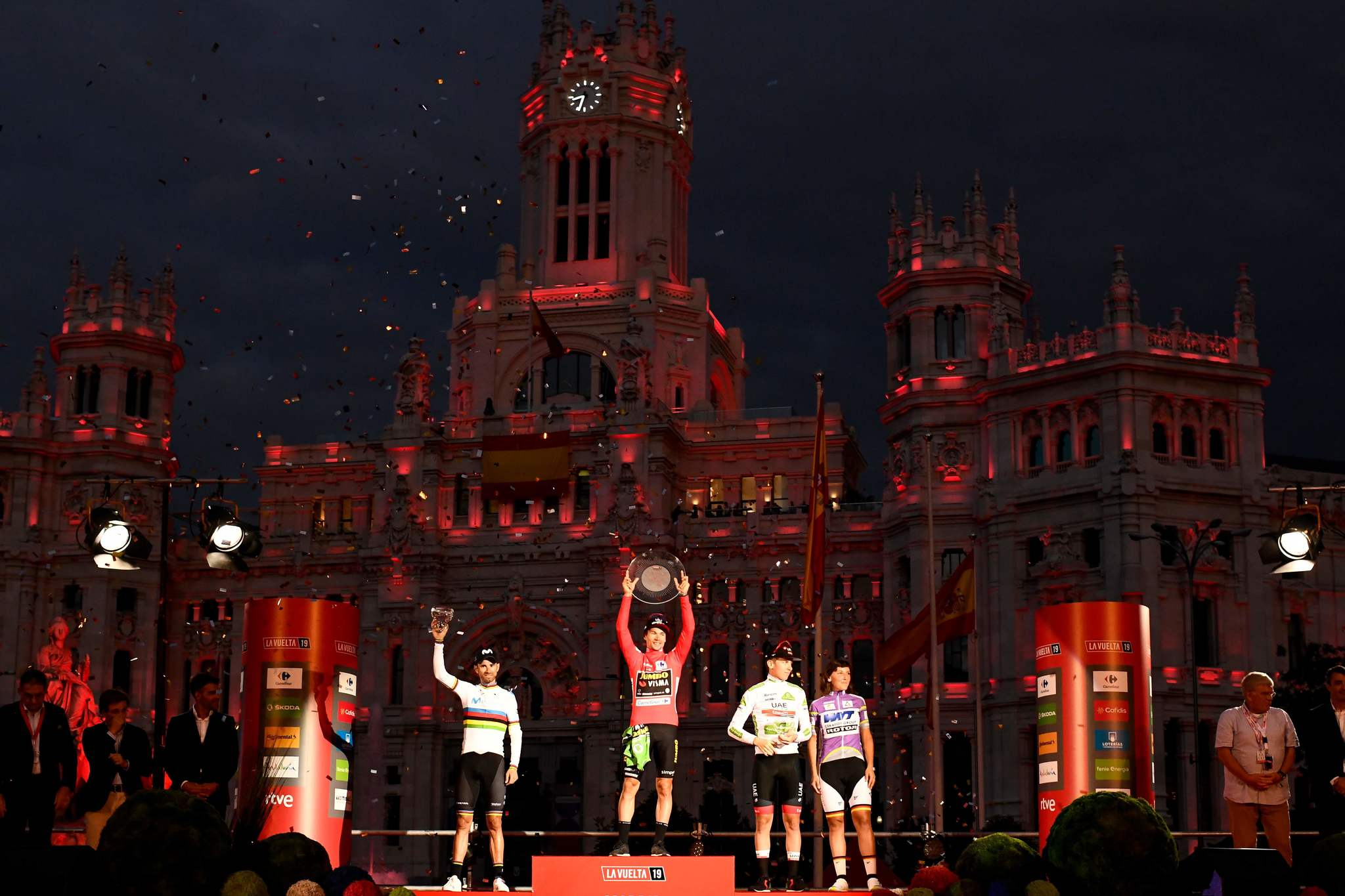 (LtoR) Second-placed Team Movistar rider Spains Alejandro Valverde, winner Team Jumbo rider Slovenias Primoz <HIT>Roglic</HIT> and third-placed Team UAE Emirates rider Slovenias Tadej Pogacar, celebrate on the podium after the 21st and and last stage of the 2019 La Vuelta cycling Tour of Spain, a 106,6 km race from Fuenlabrada to Madrid on September 15, 2019. (Photo by OSCAR DEL POZO / AFP)