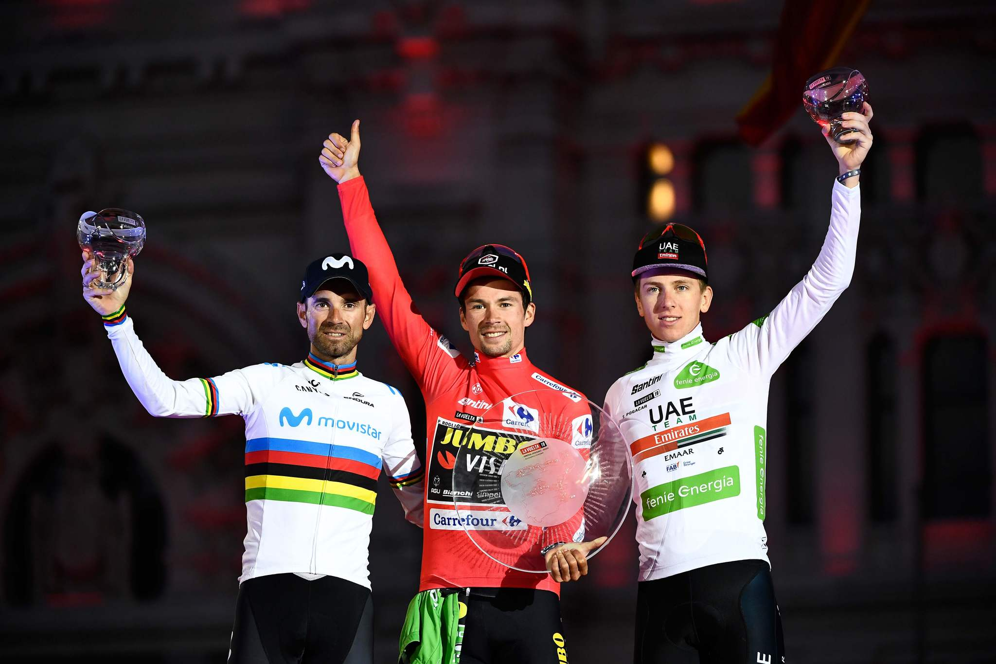 TOPSHOT - (LtoR) Second-placed Team Movistar rider Spains <HIT>Alejandro</HIT><HIT>Valverde</HIT>, winner Team Jumbo rider Slovenias Primoz Roglic and third-placed Team UAE Emirates rider Slovenias Tadej Pogacar, celebrate on the podium after the 21st and and last stage of the 2019 La Vuelta cycling Tour of Spain, a 106,6 km race from Fuenlabrada to Madrid on September 15, 2019. (Photo by OSCAR DEL POZO / AFP)