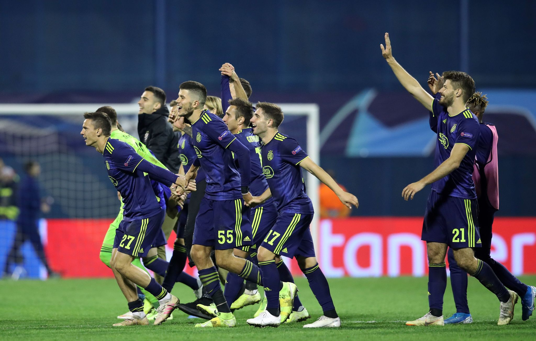 Dinamos players celebrate their victory at the end of the UEFA Champions League Group C football match GNK Dinamo vs <HIT>Atalanta</HIT> BC in Zagreb, Croatia, on September 18, 2019. - Dinamo won the match 4-0. (Photo by Damir SENCAR / AFP)