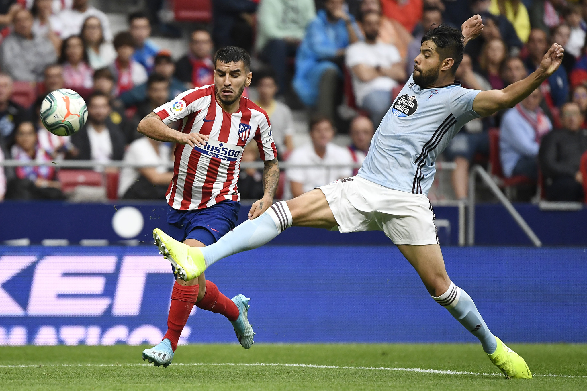 Atletico Madrids Argentine forward Angel <HIT>Correa</HIT> (L) vies with Celta Vigos Mexican defender Nestor Araujo during the Spanish league football match between Club Atletico de Madrid and RC Celta de Vigo at the Wanda Metropolitano stadium in Madrid on September 21, 2019. (Photo by PIERRE-PHILIPPE MARCOU / AFP)