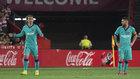 Griezmann y Messi, cariacontecidos en Los Cármenes.