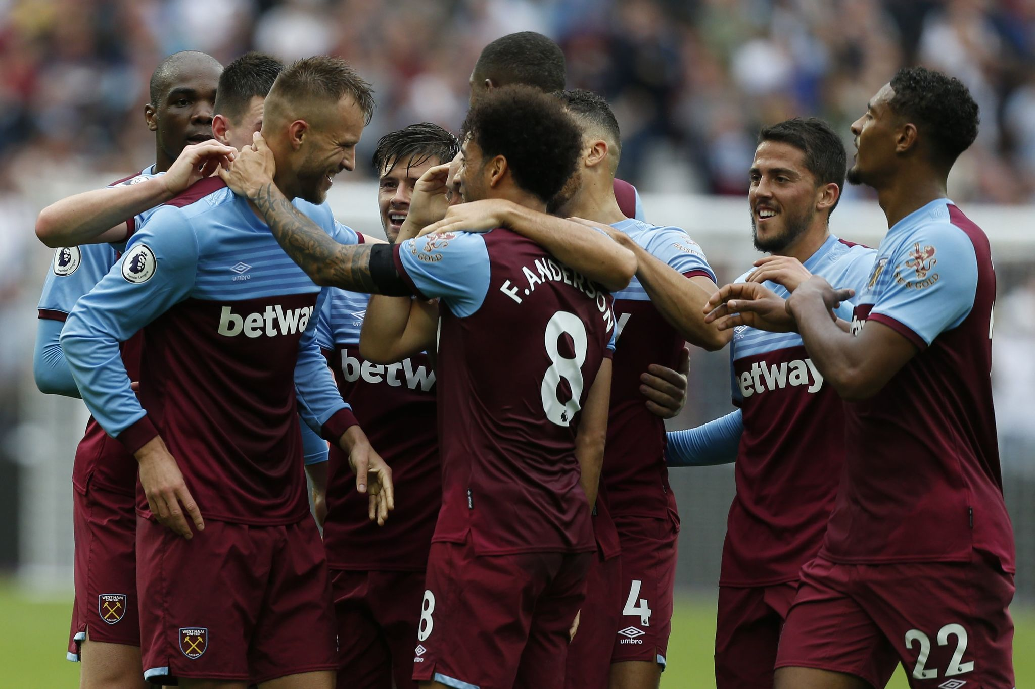 West Ham Uniteds Ukrainian striker Andriy <HIT>Yarmolenko</HIT> (L) celebrates with teammates after scoring his teams first goal during the English Premier League football match between West Ham United and Manchester United at The London Stadium, in east London on September 22, 2019. (Photo by Ian KINGTON / AFP) / RESTRICTED TO EDITORIAL USE. No use with unauthorized audio, video, data, fixture lists, club/league logos or live services. Online in-match use limited to 120 images. An additional 40 images may be used in extra time. No video emulation. Social media in-match use limited to 120 images. An additional 40 images may be used in extra time. No use in betting publications, games or single club/league/player publications. /