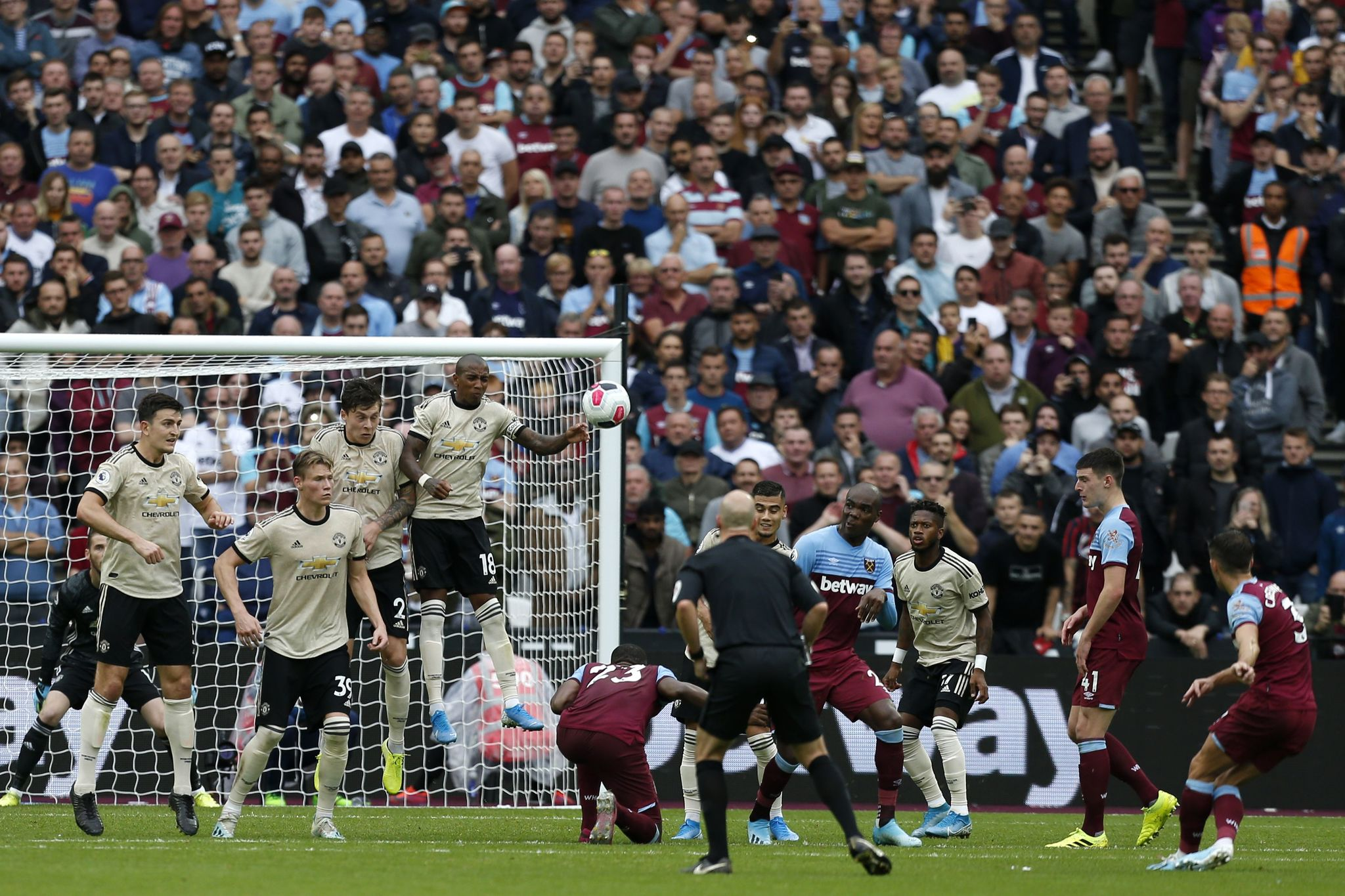 West Ham Uniteds English defender Aaron <HIT>Cresswell</HIT> (R) takes a free kick during the English Premier League football match between West Ham United and Manchester United at The London Stadium, in east London on September 22, 2019. (Photo by Ian KINGTON / AFP) / RESTRICTED TO EDITORIAL USE. No use with unauthorized audio, video, data, fixture lists, club/league logos or live services. Online in-match use limited to 120 images. An additional 40 images may be used in extra time. No video emulation. Social media in-match use limited to 120 images. An additional 40 images may be used in extra time. No use in betting publications, games or single club/league/player publications. /