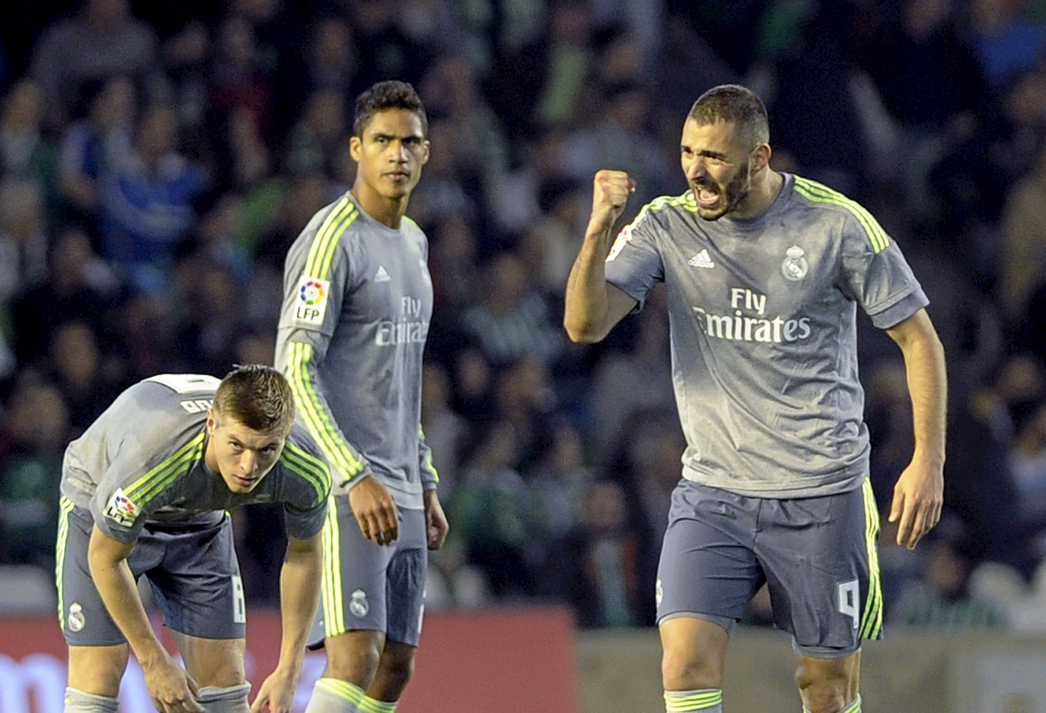 Real Madrids French forward Karim <HIT>Benzema</HIT> (R) celebrates a goal during the Spanish league football match Real Betis Balompie vs Real Madrid CF at the Benito Villamarin stadium in Sevilla on January 24, <HIT>2016</HIT>. AFP PHOTO / CRISTINA QUICLER