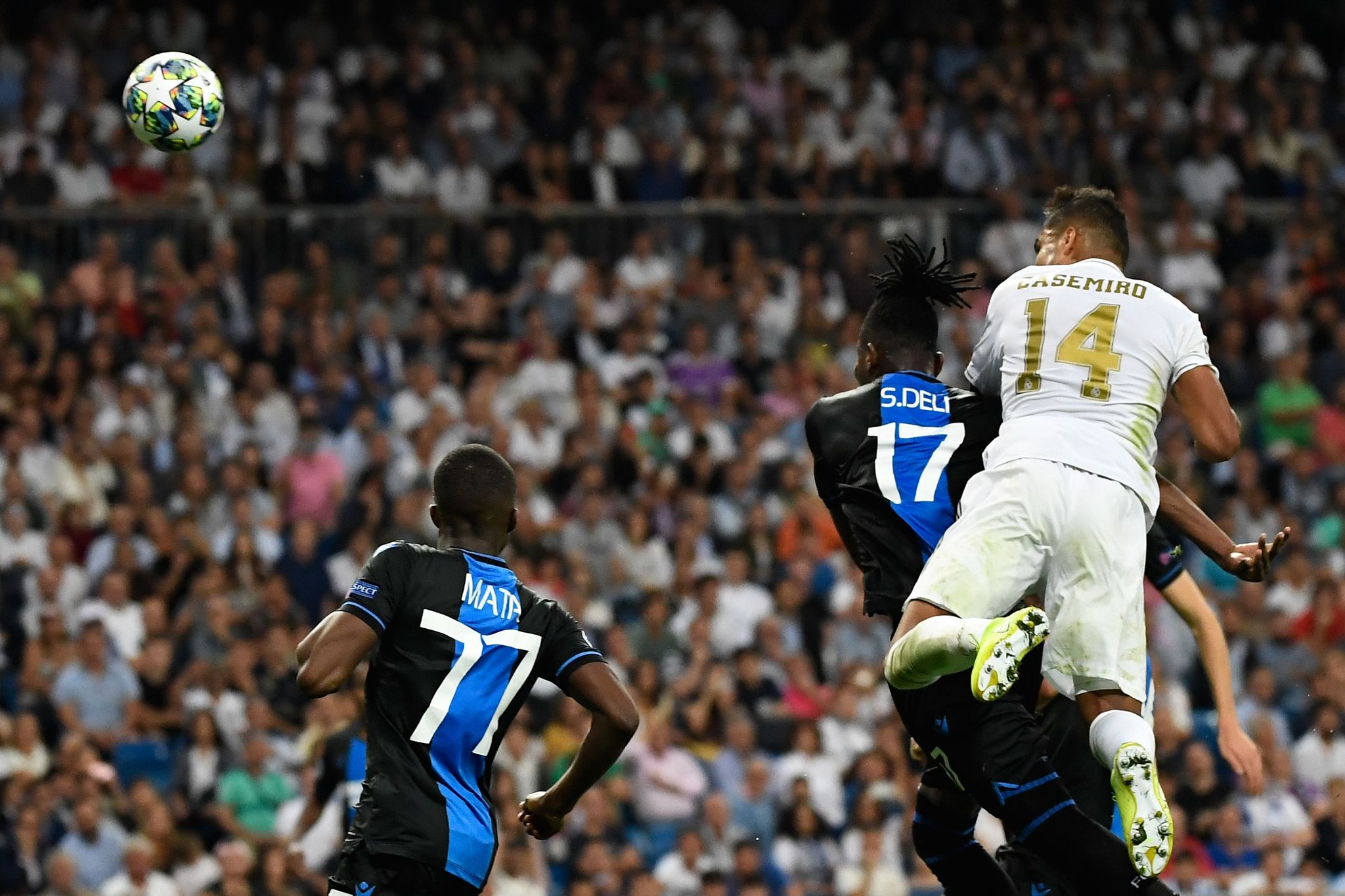 TOPSHOT - Real Madrids Brazilian midfielder <HIT>Casemiro</HIT> (R) scores a goal during the UEFA Champions league Group A football match between Real Madrid and Club Brugge at the Santiago Bernabeu stadium in Madrid on October 1, 2019. (Photo by PIERRE-PHILIPPE MARCOU / AFP)
