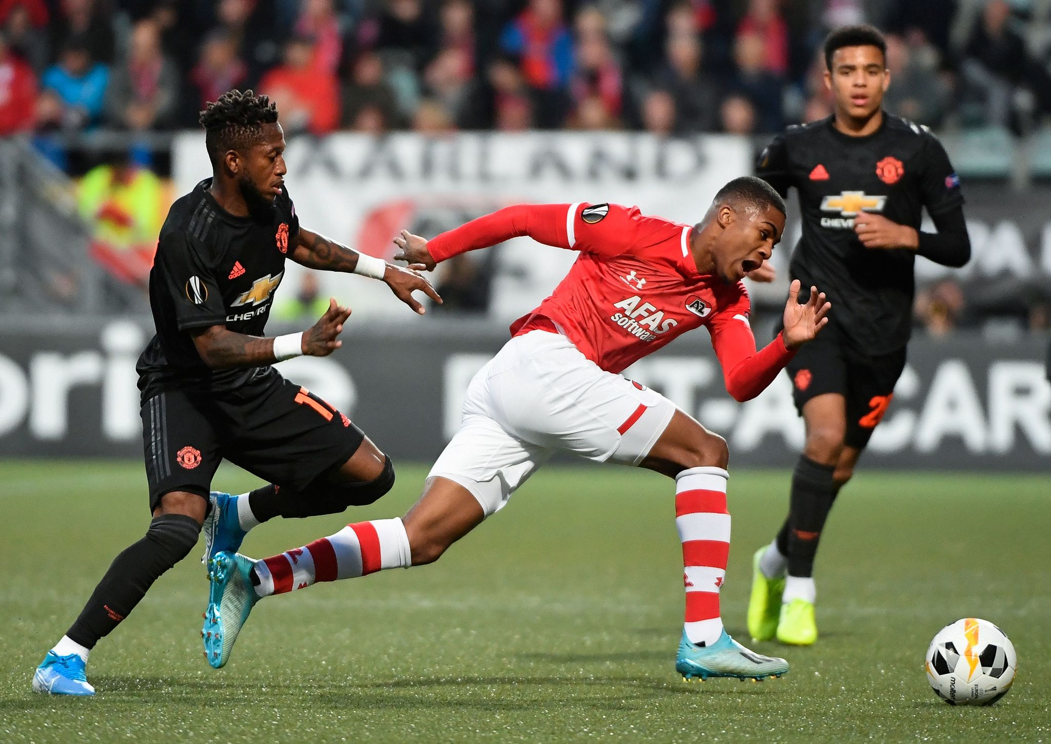 Manchester <HIT>United</HIT>s Brazilian midfielder Fred (L) fights for the ball with AZ Alkmaars Dutch forward Myron Boadu during the UEFA Europa League Group L football match berween AZ Alkmaar and Manchester <HIT>United</HIT> at the ADO Stadium in The Hague, on October 3, 2019. (Photo by JOHN THYS / AFP)