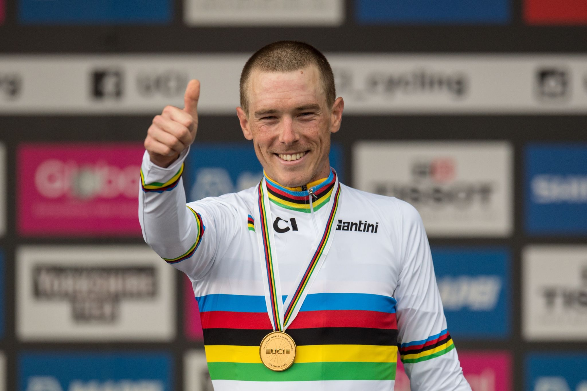 Australias <HIT>Rohan</HIT><HIT>Dennis</HIT> celebrates on the podium after winning the Elite Men Individual Time Trial, over 54 kms from Northallerton to Harrogate, at the 2019 UCI Road World Championships in Harrogate, northern England on September 25, 2019. (Photo by OLI SCARFF / AFP)