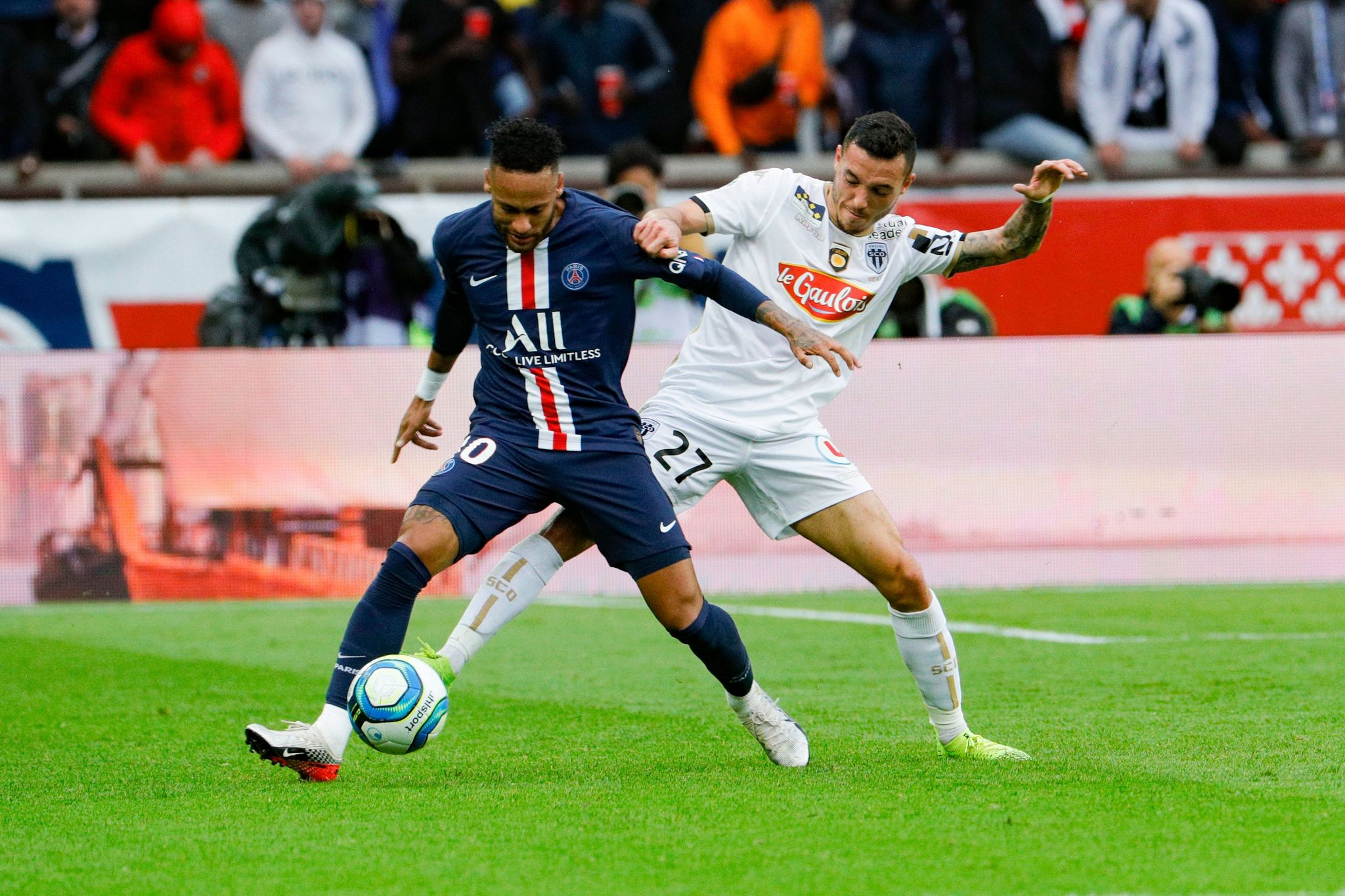 Paris Saint-Germains Brazilian forward <HIT>Neymar</HIT> (L) fights for the ball with Angers Franco-Portuguese midfielder Mathias Pereira Lage during the French L1 football match between Paris Saint-Germain and Angers SCO at the Parc des Princes stadium in Paris on October 5, 2019. (Photo by GEOFFROY VAN DER HASSELT / AFP)