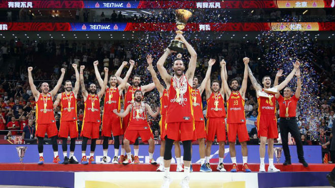 Rudy Fernandez lifting the FIBA World Cup trophy with his Spain...