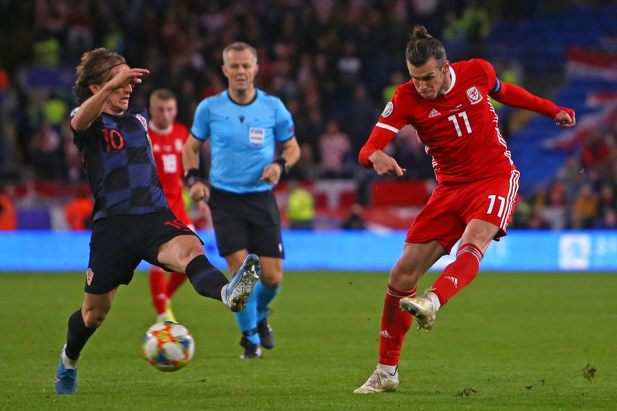 Wales striker Gareth <HIT>Bale</HIT> (R) has an unsuccessful shot under pressure from Croatias midfielder Luka <HIT>Modric</HIT> (L) during the Euro 2020 football qualification match between Wales and Croatia at Cardiff City Stadium, Cardiff on October 13, 2019. (Photo by GEOFF CADDICK / AFP)