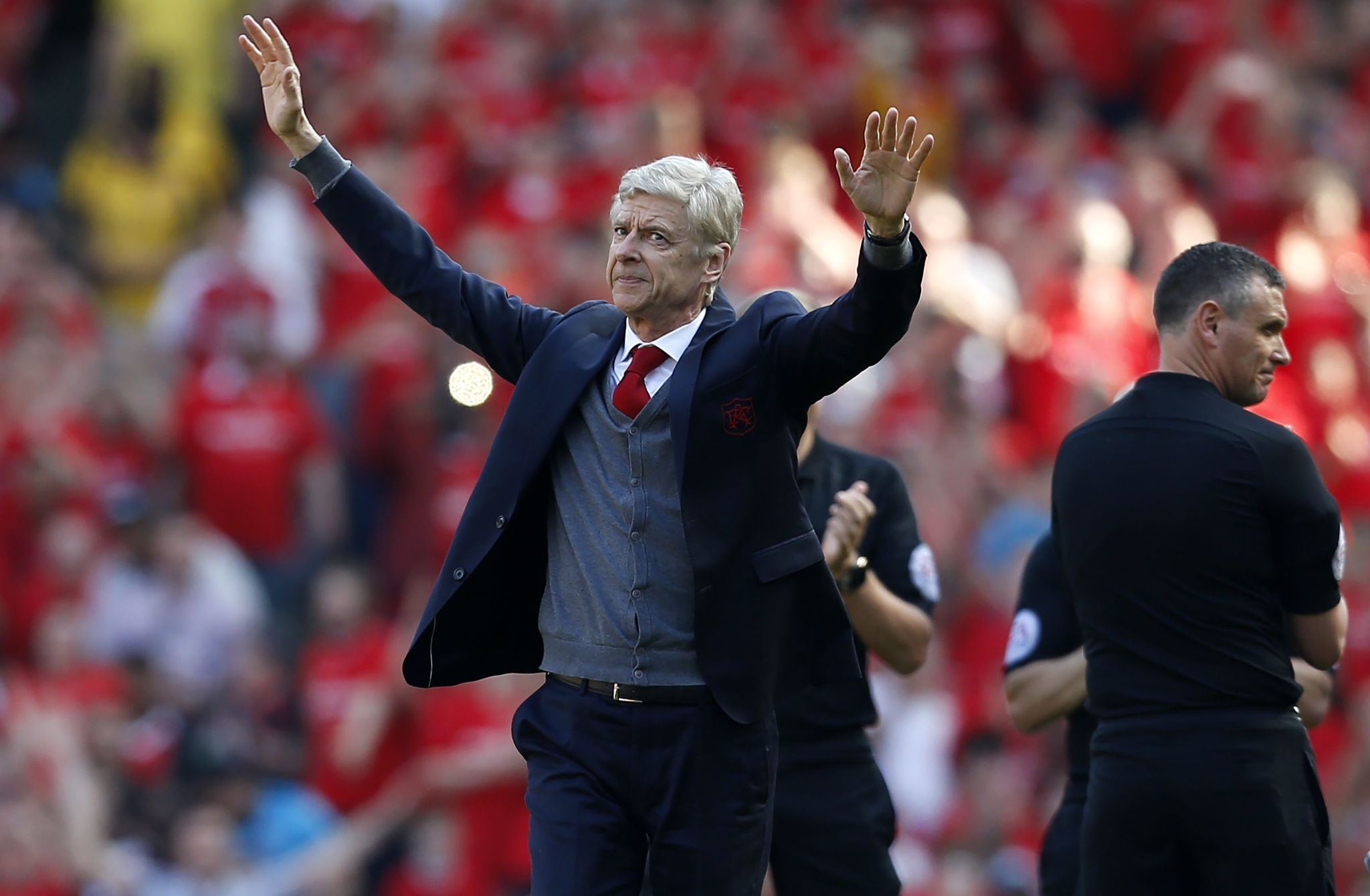 Arsenals French manager Arsene <HIT>Wenger</HIT> salutes the crowd as he arrives for the English Premier League football match between Arsenal and Burnley at the Emirates Stadium in London on May 6, 2018. Arsene <HIT>Wenger</HIT> bids farewell to a stadium he helped to build in more ways than one when he leads Arsenal at the Emirates for the final time at home to Burnley on Sunday. <HIT>Wenger</HIT>s final season after 22 years in charge is destined to end in disappointment after Thursdays Europa League semi-final exit. / AFP PHOTO / IKIMAGES / Ian KINGTON / RESTRICTED TO EDITORIAL USE. No use with unauthorized audio, video, data, fixture lists, club/league logos or live services. Online in-match use limited to 45 images, no video emulation. No use in betting, games or single club/league/player publications. /