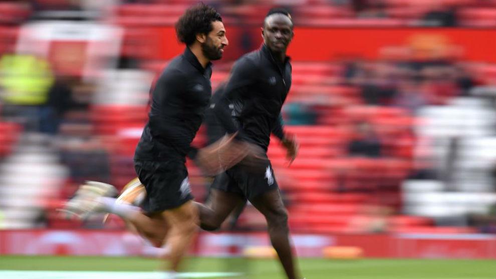 Sané y Salah en un calentamiento.
