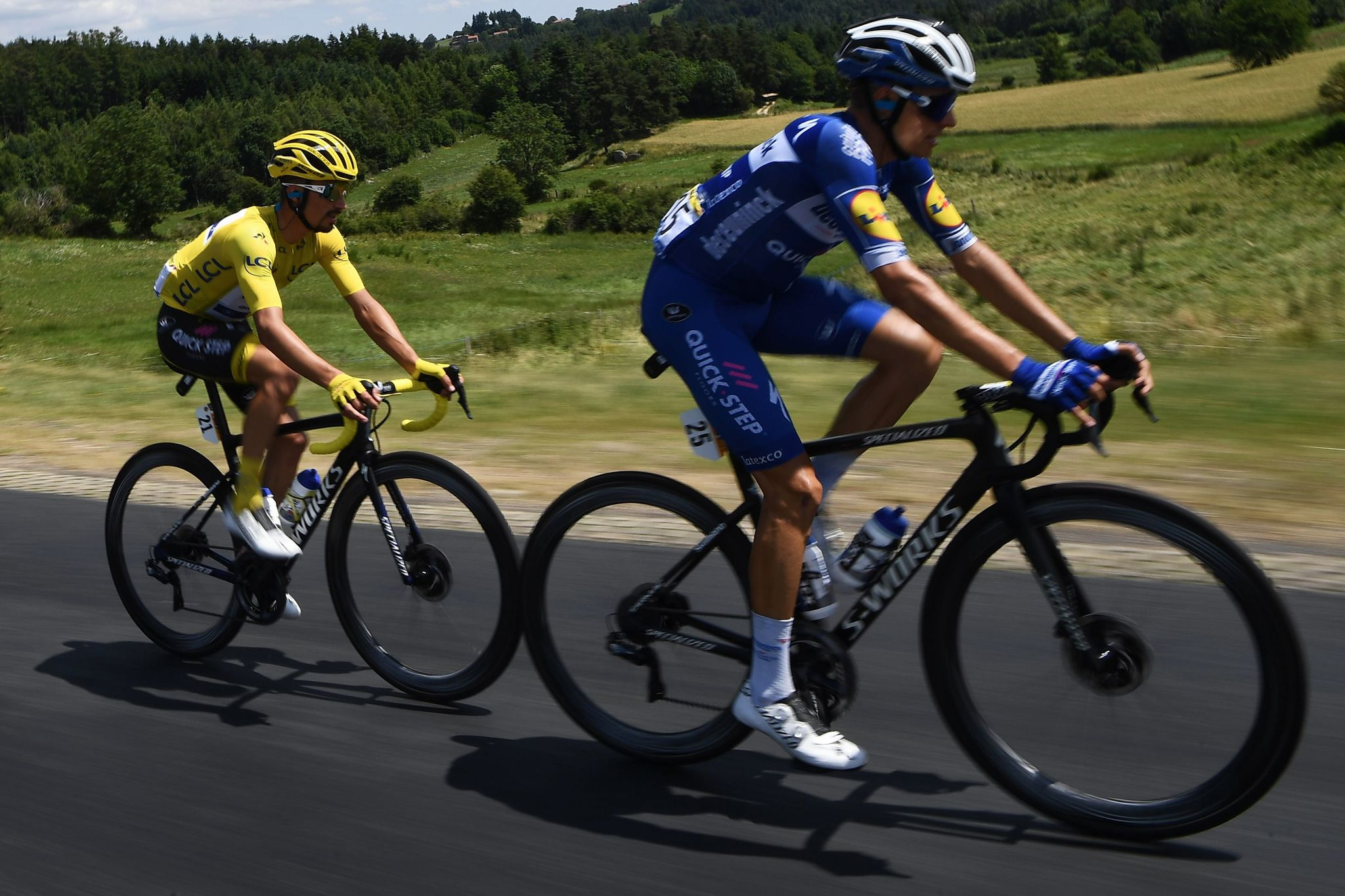 Frances Julian Alaphilippe (L), wearing the overall leaders yellow jersey rides with Spains <HIT>Enric</HIT><HIT>Mas</HIT> during the ninth stage of the 106th edition of the Tour de France cycling race between Saint-Etienne and Brioude, on July 14, 2019. (Photo by Anne-Christine POUJOULAT / AFP)