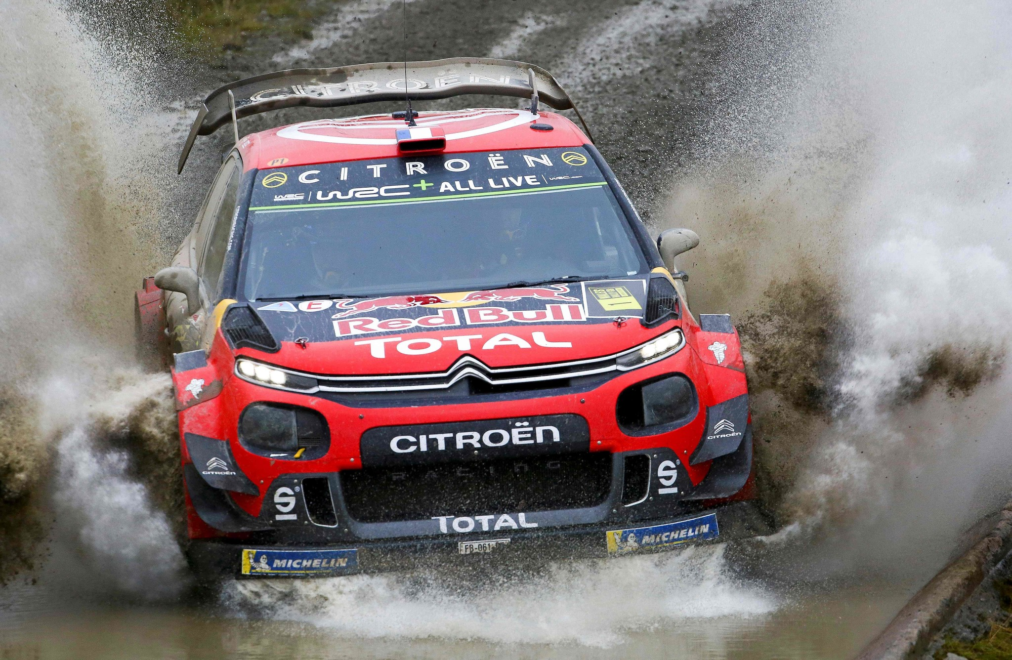French pilot Sebastien <HIT>Ogier</HIT> and co-pilot Julien Ingrassia of the Citroen Total WRT drive their Citroen C3 WRC as they compete in the Sweet Lamb stage of the Wales Rally GB, the 12th round of the FIA World Rally Championship, in north west Wales on October 5, 2019. (Photo by GEOFF CADDICK / AFP)