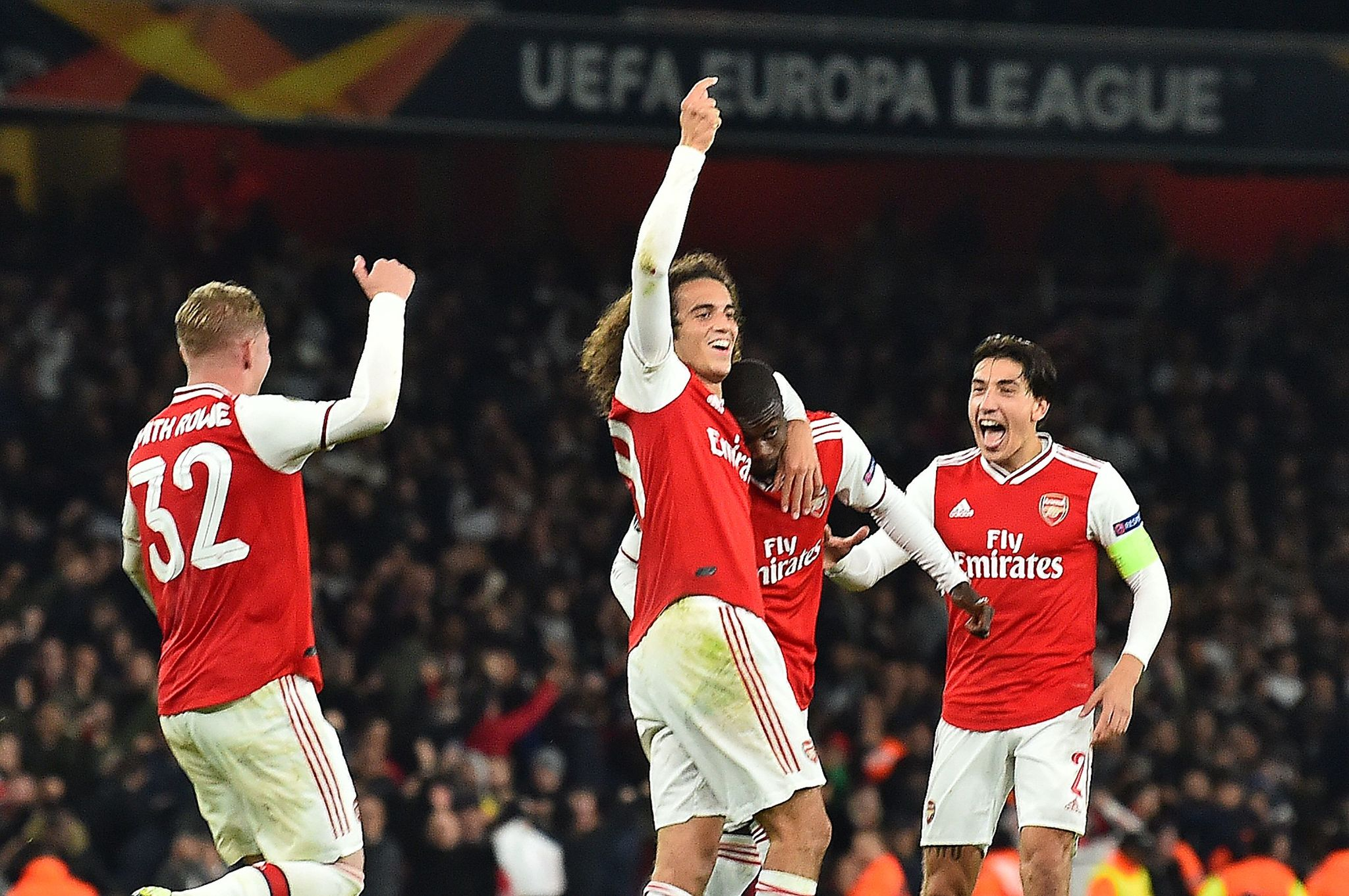 <HIT>Arsenal</HIT>s French-born Ivorian midfielder Nicolas Pepe (2R) celebrates scoring his teams third goal during their UEFA Europa league Group F football match between <HIT>Arsenal</HIT> and Vitoria Guimaraes at the Emirates stadium in London on October 24, 2019. (Photo by Glyn KIRK / AFP)