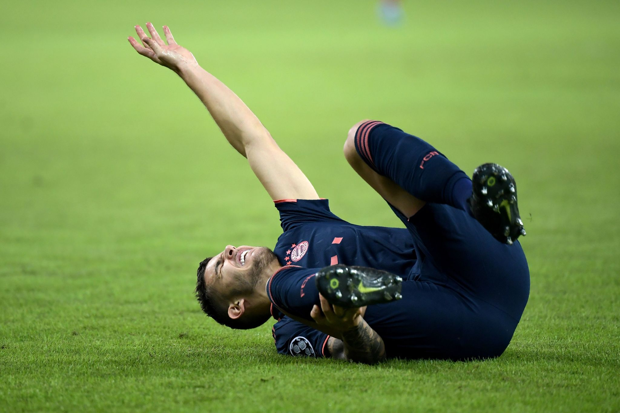 Bayern Munichs French defender <HIT>Lucas</HIT><HIT>Hernandez</HIT> (C) lies on the pitch injured during the UEFA Champions League group B football match between Olympiacos FC and FC Bayern Munchen at the Georgios Karaiskakis stadium in Piraeus near Athens, on October 22, 2019. (Photo by ARIS MESSINIS / AFP)