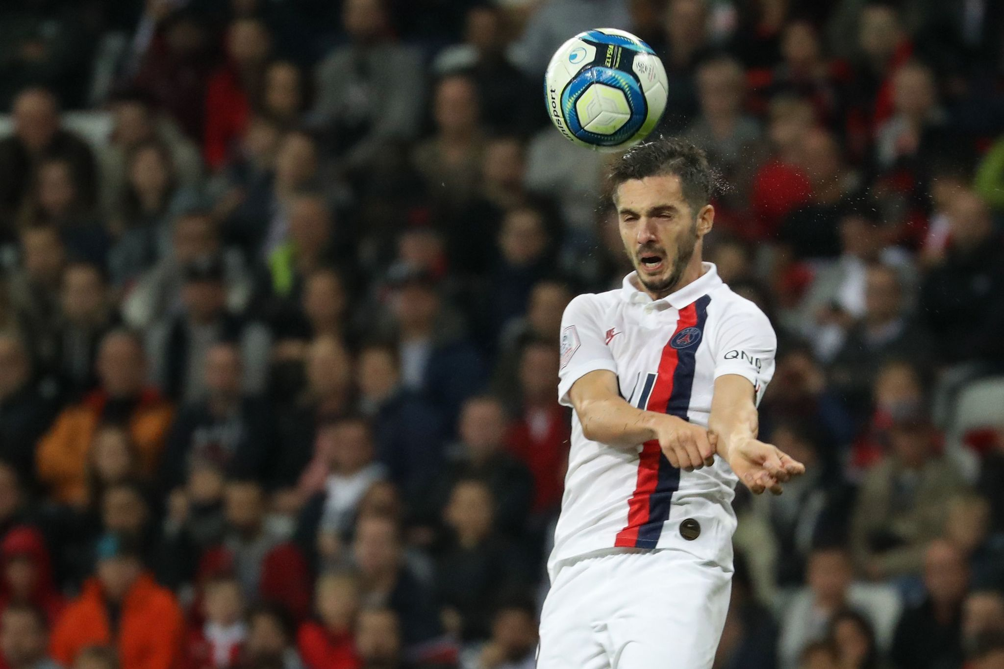"""Paris Saint-Germains Spanish midfielder Pablo <HIT>Sarabia</HIT> heads the ball during the French L1 football match between OGC Nice (OGCN) and Paris Saint-Germain (PSG) at """"Allianz Riviera"""" stadium in Nice, southern France, on October 18, 2019. (Photo by Valery HACHE / AFP)"""