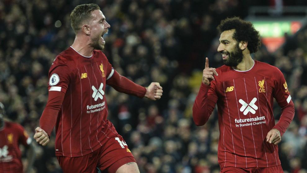 Henderson y Salah, los goleadores del Liverpool ante el Tottenham