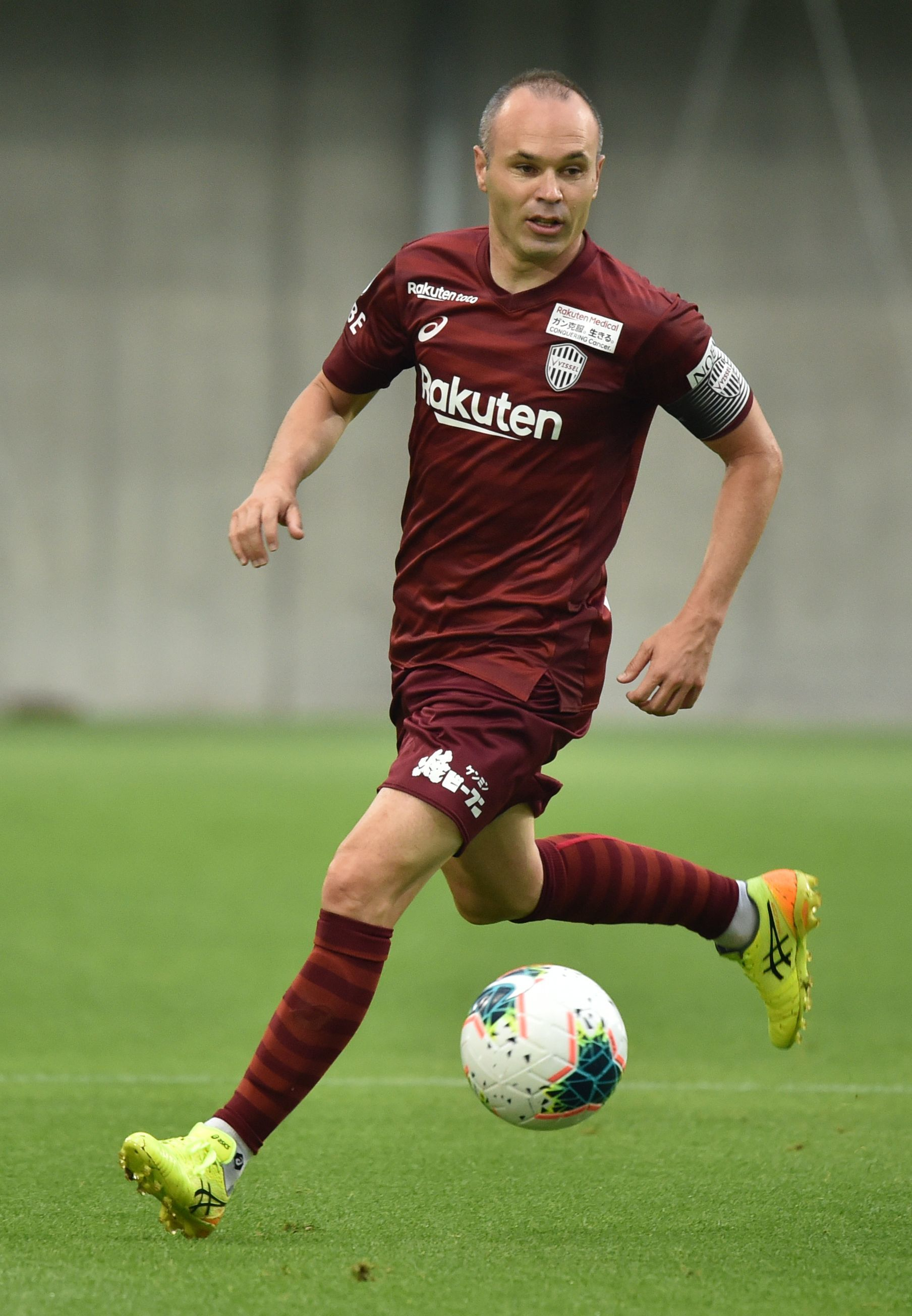 Vissel Kobes Spanish midfielder <HIT>Andres</HIT><HIT>Iniesta</HIT> dribbles the ball during the Rakuten Cup football match between Vissel Kobe and FC Barcelona, in Kobe on July 27, 2019. (Photo by Kazuhiro NOGI / AFP)