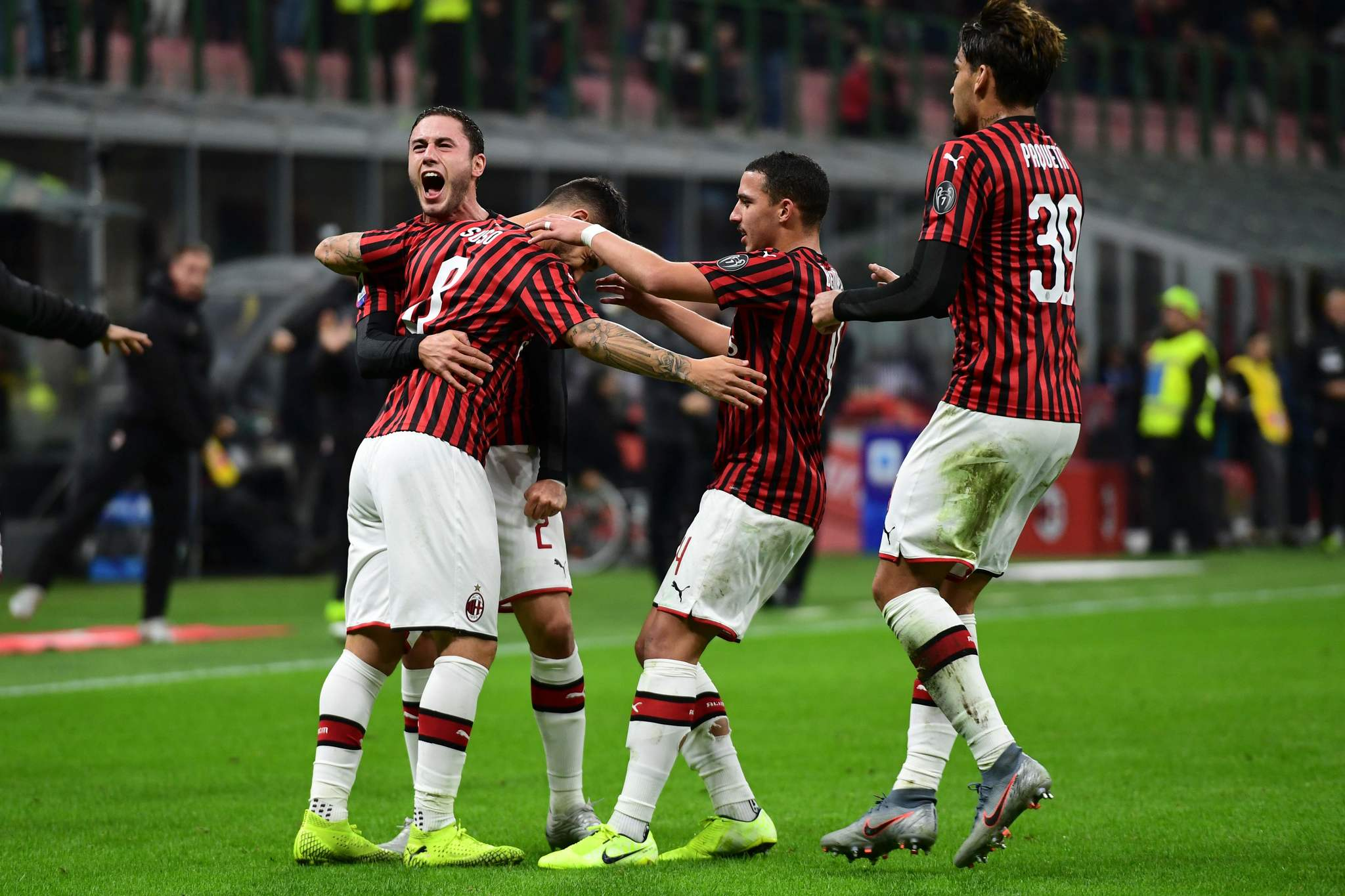 AC <HIT>Milan</HIT>s Spanish forward Suso (2L) celebrates scoring his teams first goal with AC <HIT>Milan</HIT>s Italian defender Davide Calabria (L), AC <HIT>Milan</HIT>s Algerian defender Ismael Bennacer and AC <HIT>Milan</HIT>s Brazilian midfielder Lucas Paqueta (R) during the Italian Serie A football match AC <HIT>Milan</HIT> vs Spal on October 31, 2019 at the San Siro stadium in <HIT>Milan</HIT>. (Photo by MIGUEL MEDINA / AFP)