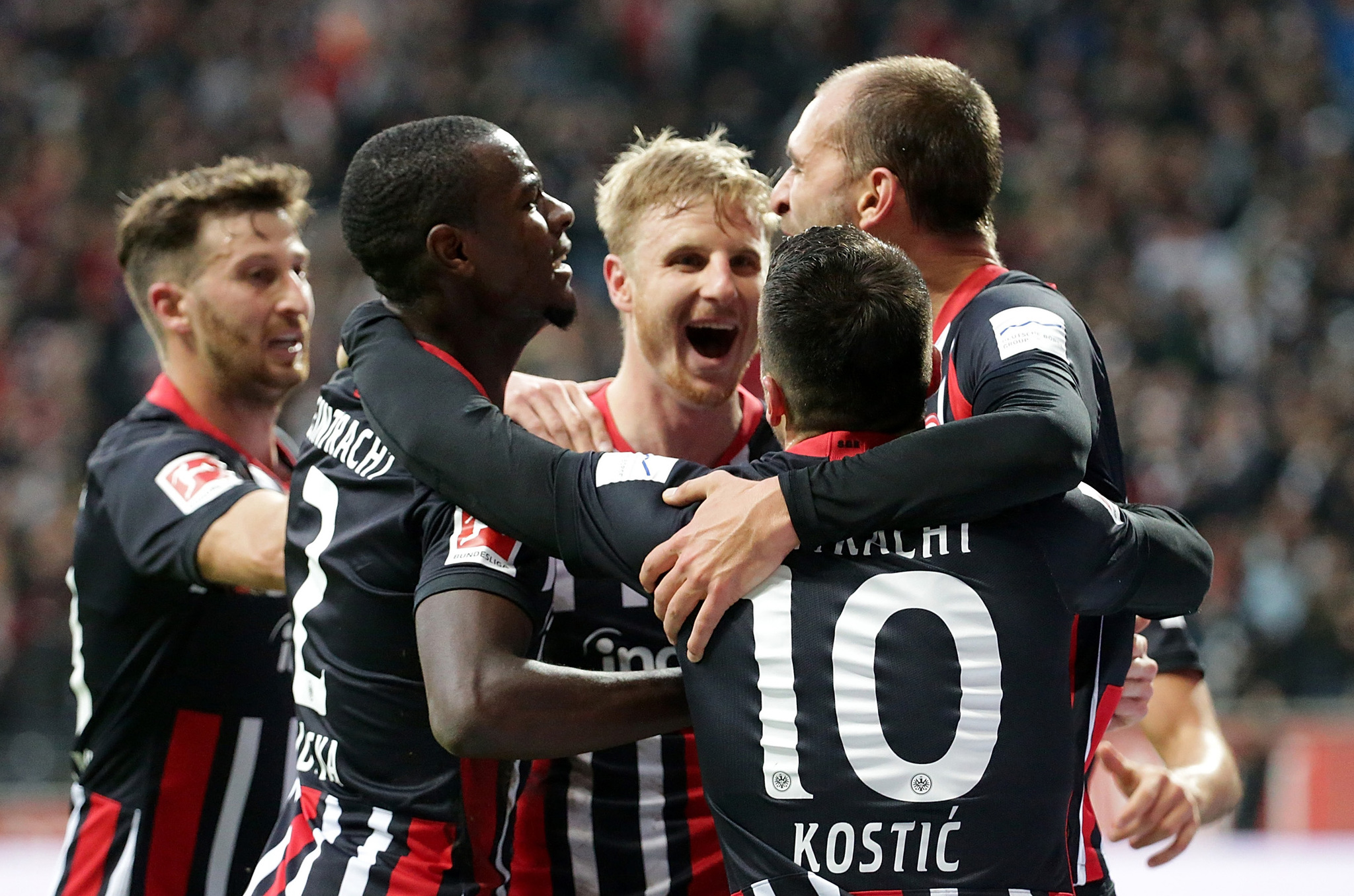Frankfurts German defender Martin Hinteregger (L) celebrates after scoring the 4-1 during the German first division Bundesliga football match between Eintracht Frankfurt and FC <HIT>Bayern</HIT> Munich on November 2, 2019 in Frankfurt am Main, western Germany; (L-R) Frankfurts Argentinian defender David Abraham, Frankfurts French defender Evan NDicka, Frankfurts German defender Martin Hinteregger, Frankfurts Serbian midfielder Filip Kostic and Frankfurts Dutch forward Bas Dost. (Photo by Hasan Bratic / DPA / AFP) / Germany OUT / DFL REGULATIONS PROHIBIT ANY USE OF PHOTOGRAPHS AS IMAGE SEQUENCES AND/OR QUASI-VIDEO