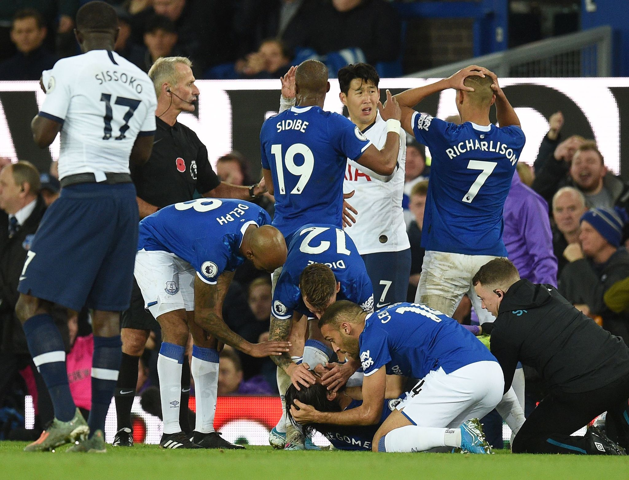 Teammates comfort Evertons Portuguese midfielder <HIT>André</HIT><HIT>Gomes</HIT> (C floor) as he gets attention for an injury during the English Premier League football match between Everton and Tottenham Hotspur at Goodison Park in Liverpool, north west England on November 3, 2019. (Photo by Oli SCARFF / AFP) / RESTRICTED TO EDITORIAL USE. No use with unauthorized audio, video, data, fixture lists, club/league logos or live services. Online in-match use limited to 120 images. An additional 40 images may be used in extra time. No video emulation. Social media in-match use limited to 120 images. An additional 40 images may be used in extra time. No use in betting publications, games or single club/league/player publications. /