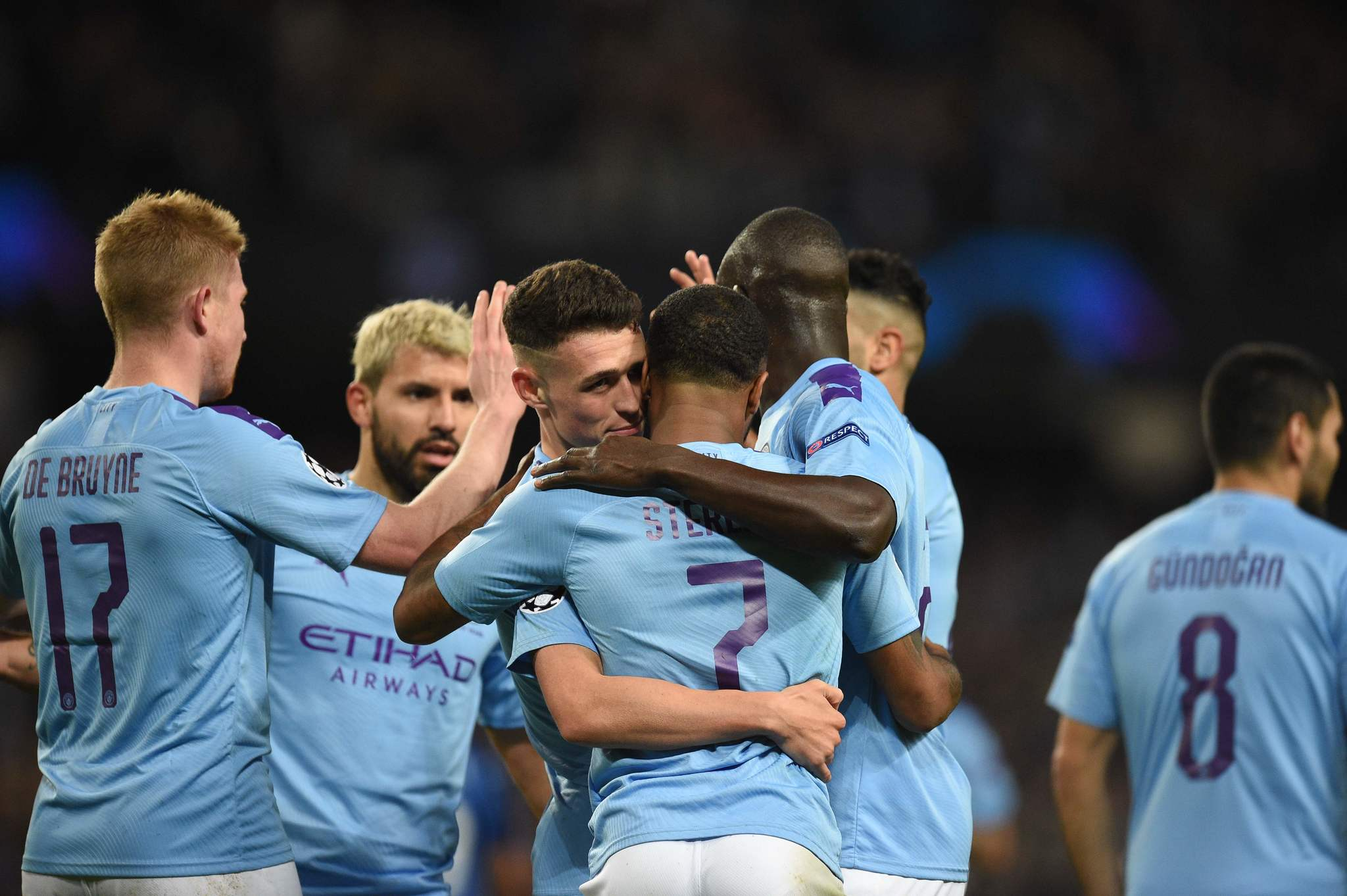 Manchester Citys English midfielder Raheem <HIT>Sterling</HIT> (C) is embraced by Manchester Citys English midfielder Phil Foden after <HIT>Sterling</HIT> scored their third goal during the UEFA Champions League Group C football match between Manchester City and Atalanta at the Etihad Stadium in Manchester, northwest England on October 22, 2019. (Photo by Oli SCARFF / AFP)