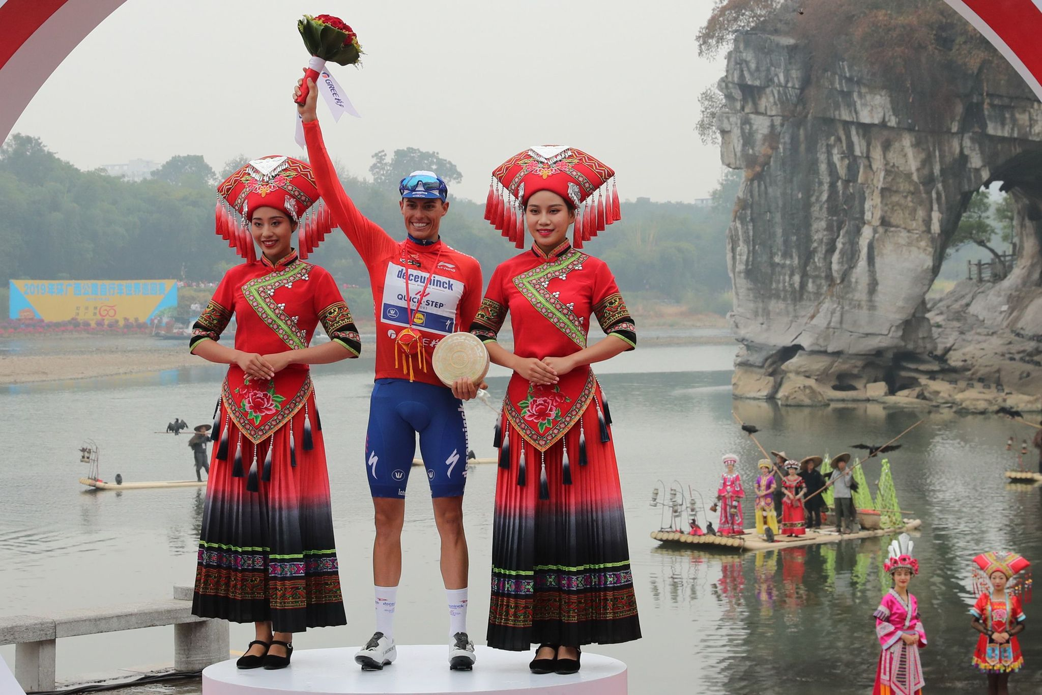<HIT>Enric</HIT><HIT>Mas</HIT> of Spain celebrates on the podium after winning the Tour of Guangxi cycling race in Guilin, in Chinas southern Guangxi province on October 22, 2019. (Photo by STR / AFP) / China OUT