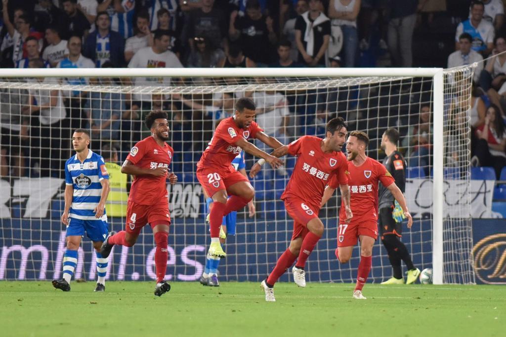 Escassi celebra el gol del empate en Riazor en el minuto 93