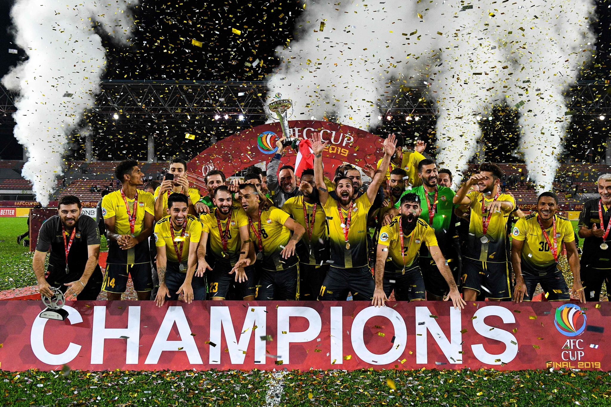 Al <HIT>Ahed</HIT>s players and coaching staff celebrate with the trophy after winning the 2019 AFC Cup Final between North Koreas April 25 Sports Club and Lebanons Al <HIT>Ahed</HIT> FC at Kuala Lumpur Stadium in Kuala Lumpur on November 4, 2019. (Photo by Mohd RASFAN / AFP)