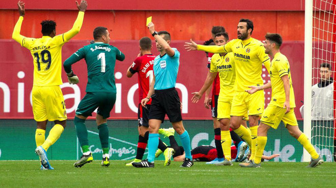 Villarreal players carry the second penalty against.