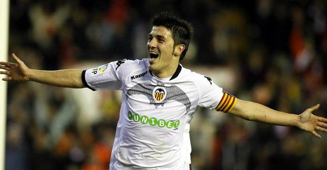 Villa celebra uno de sus 129 goles con la camiseta del Valencia