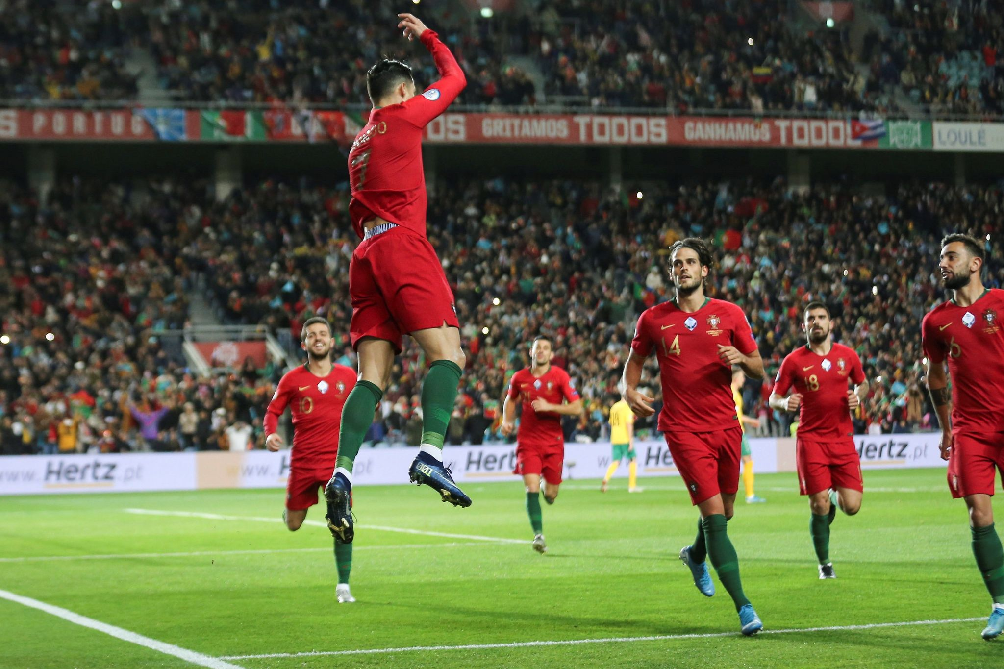 Ronaldo scores hat trick as Portugal routs Lithuania