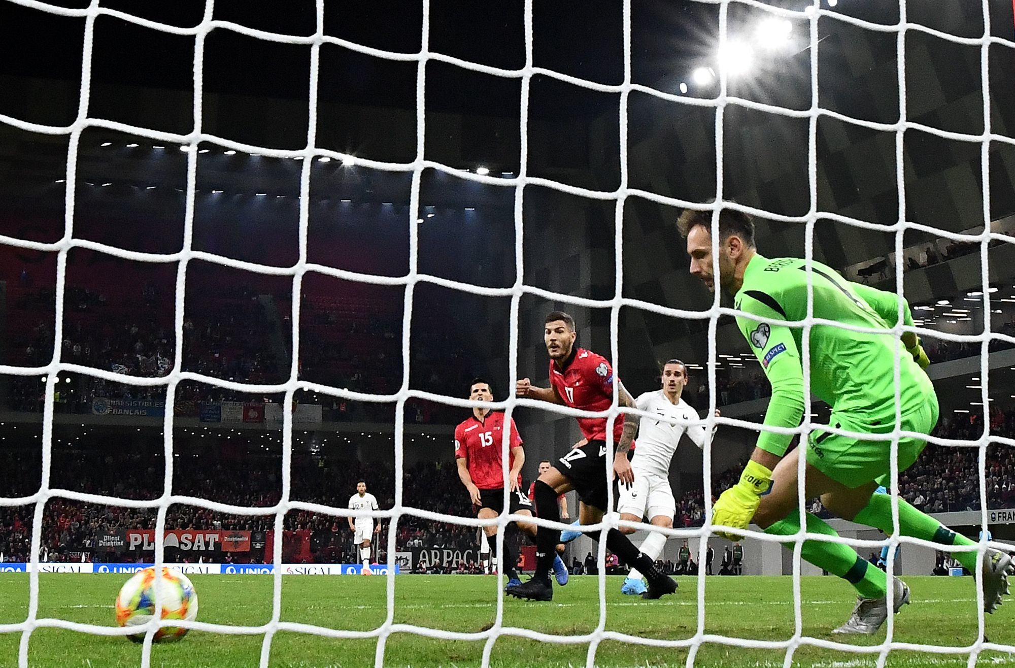 Frances forward Antoine Griezmann (C) scores a goal during the Euro 2020 Group H football qualification match between <HIT>Albania</HIT> and France at the Air <HIT>Albania</HIT> Stadium in Tirana, on November 17, 2019. (Photo by FRANCK FIFE / AFP)
