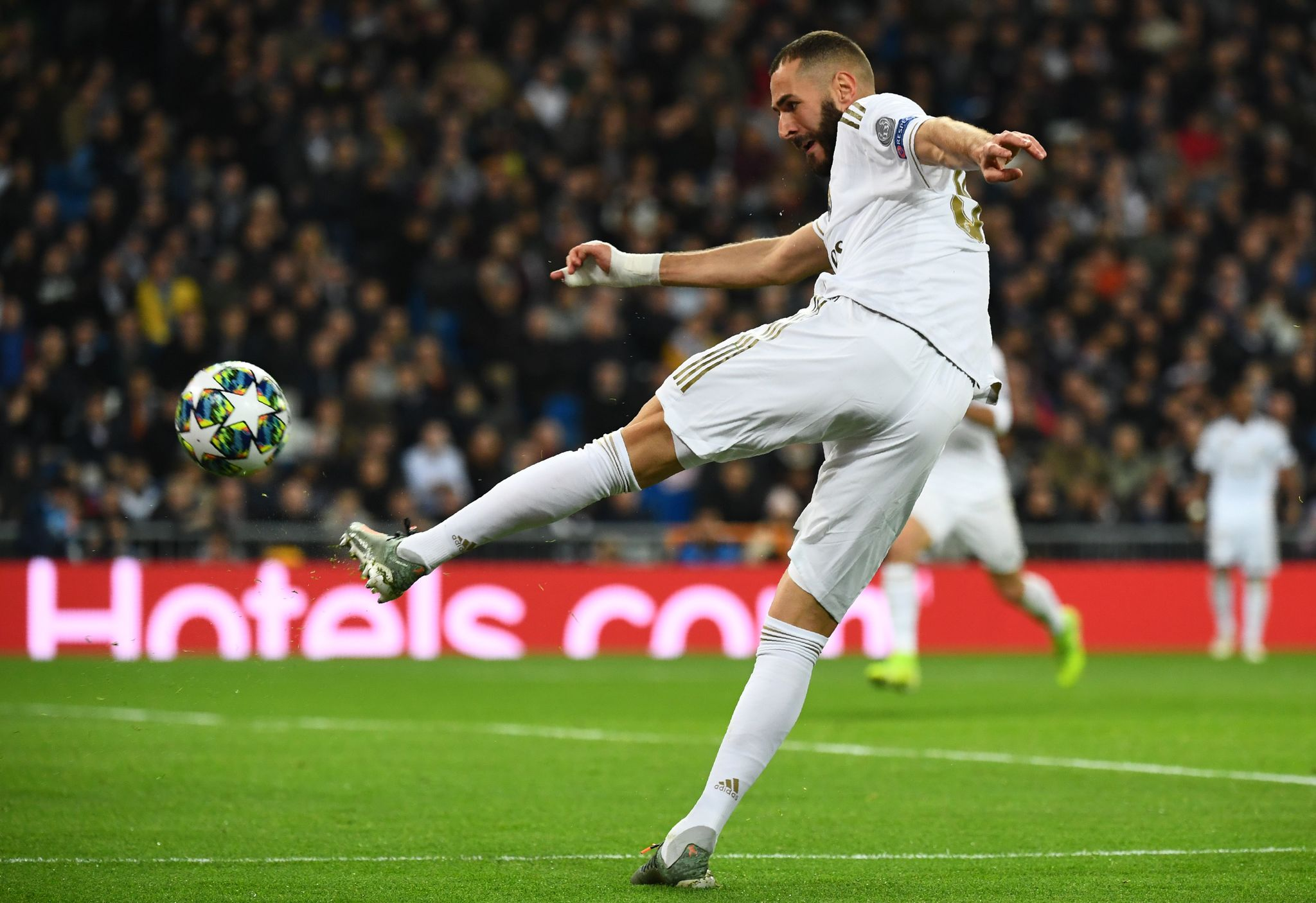 Real Madrids French forward Karim <HIT>Benzema</HIT> kicks the ball during the UEFA Champions League Group A football match between Real Madrid and Galatasaray at the Santiago Bernabeu stadium in Madrid, on November 6, 2019. (Photo by GABRIEL BOUYS / AFP)