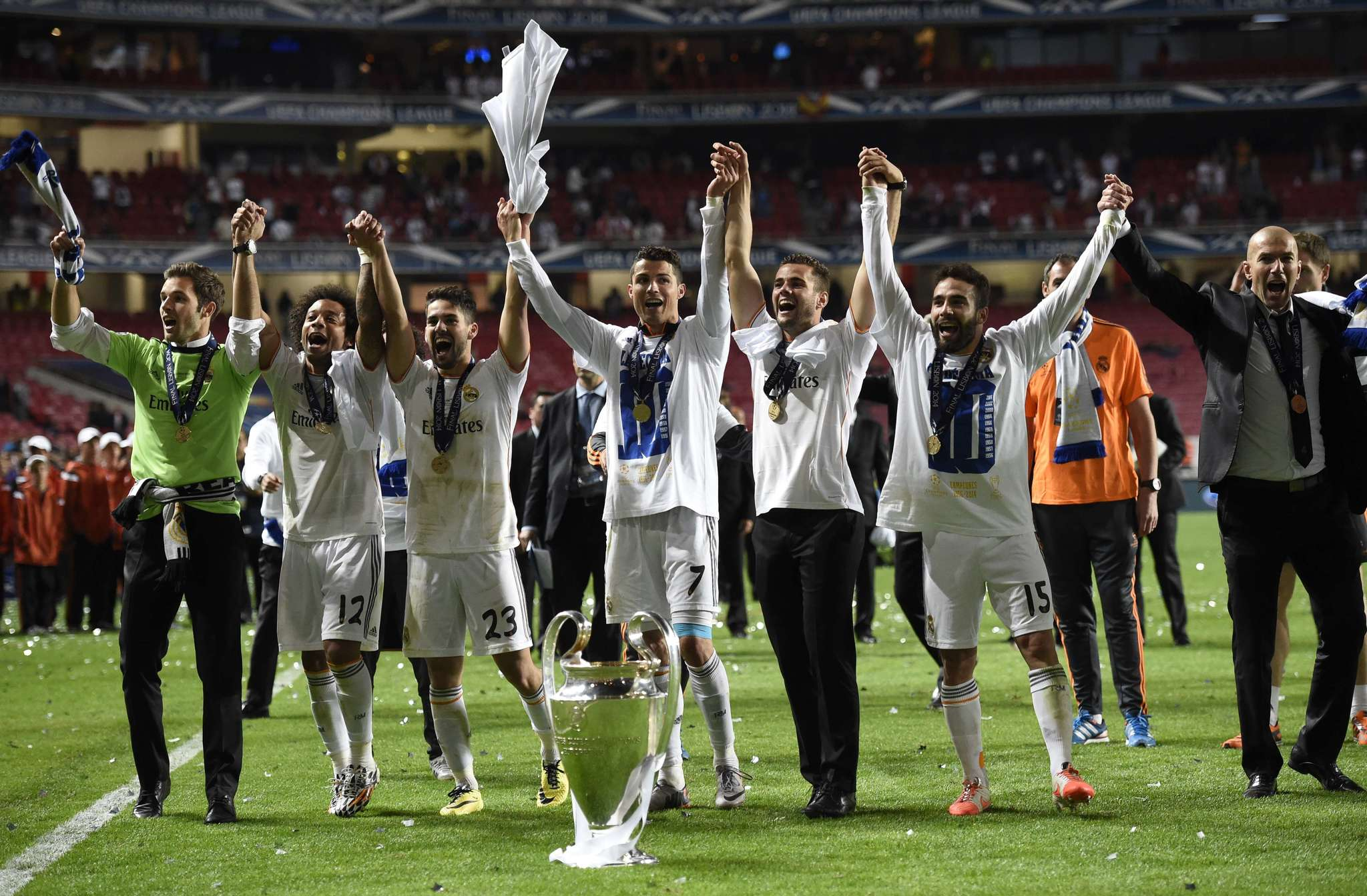 Real Madrids Brazilian defender Marcelo (2ndL), Real Madrids midfielder Isco (3rdL), Real Madrids Portuguese forward Cristiano Ronaldo (C), Real Madrids defender Daniel <HIT>Carvajal</HIT> (2ndR) and Real Madrids assistant manager Zinedine Zidane celebrate their victory at the end of the UEFA <HIT>Champions</HIT> League Final Real Madrid vs Atletico de Madrid at Luz stadium in Lisbon, on May 24, <HIT>2014</HIT>. Real Madrid won 4-1. AFP PHOTO/ FRANCK FIFE