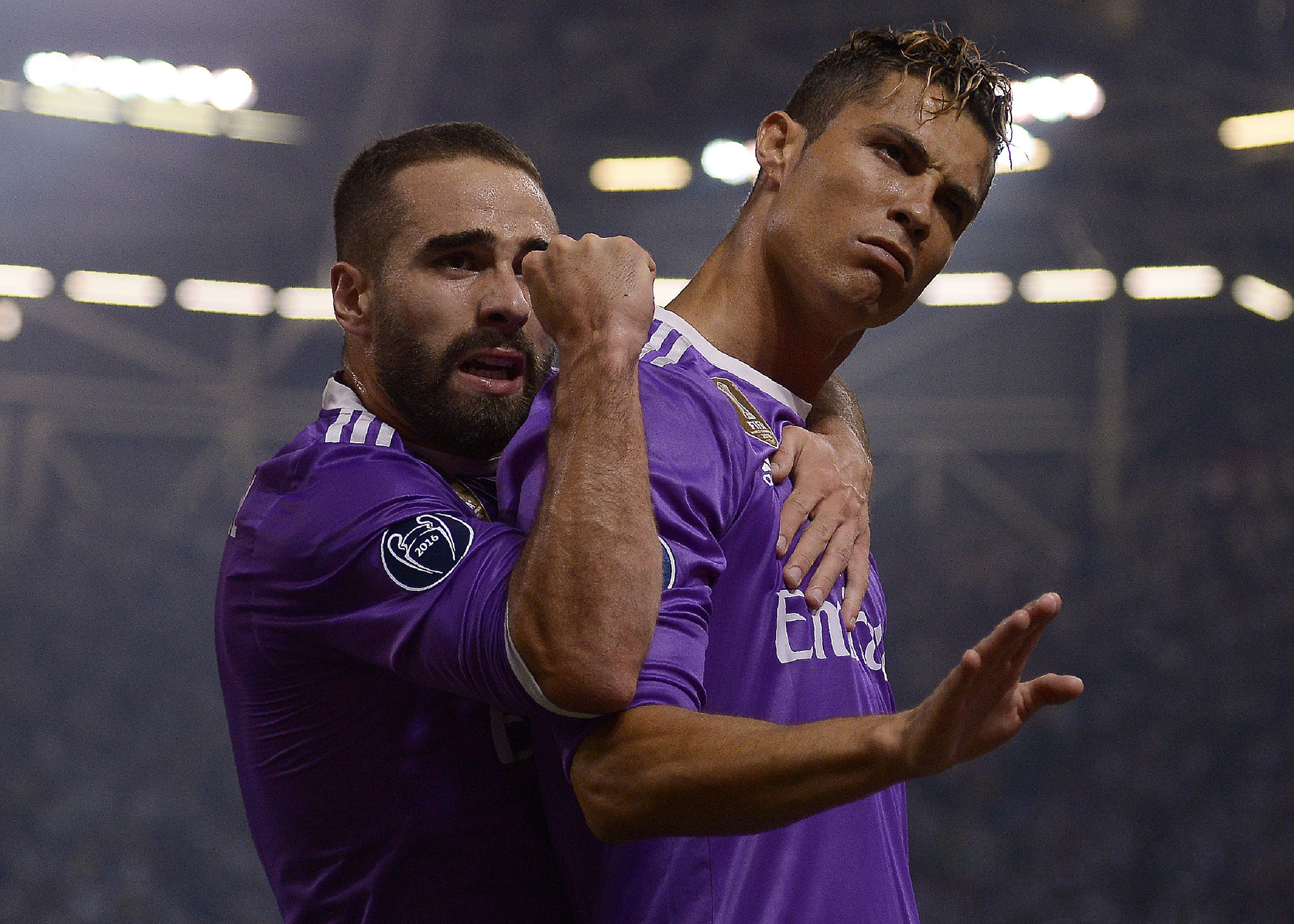 TOPSHOT - Real Madrids Portuguese striker Cristiano Ronaldo (R) celebrates with Real Madrids Spanish defender Dani <HIT>Carvajal</HIT> after scoring during the UEFA Champions League final football match between Juventus and Real Madrid at The Principality Stadium in <HIT>Cardiff</HIT>, south Wales, on June 3, 2017. / AFP PHOTO / Filippo MONTEFORTE